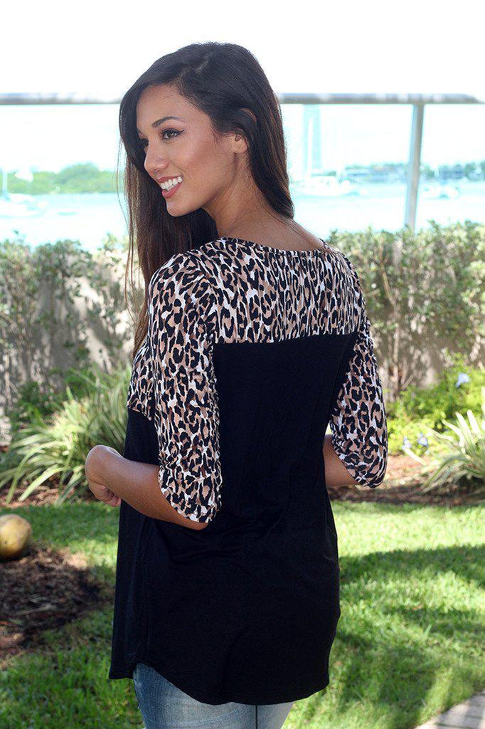black top with animal print