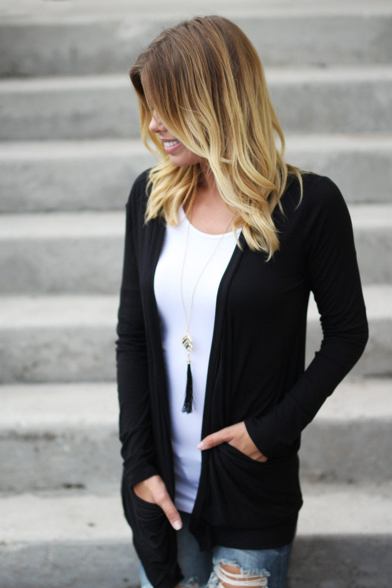 black cardigan with crochet back skull