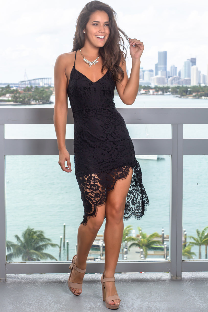woman standing in a black lace dress