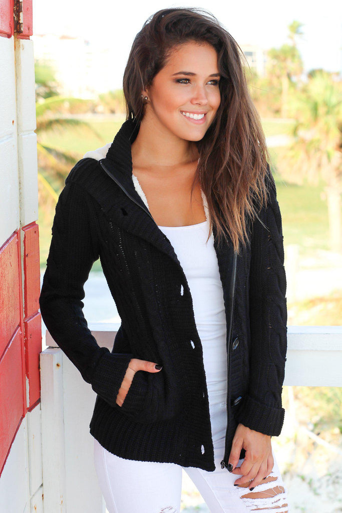 black sweater with fur hood