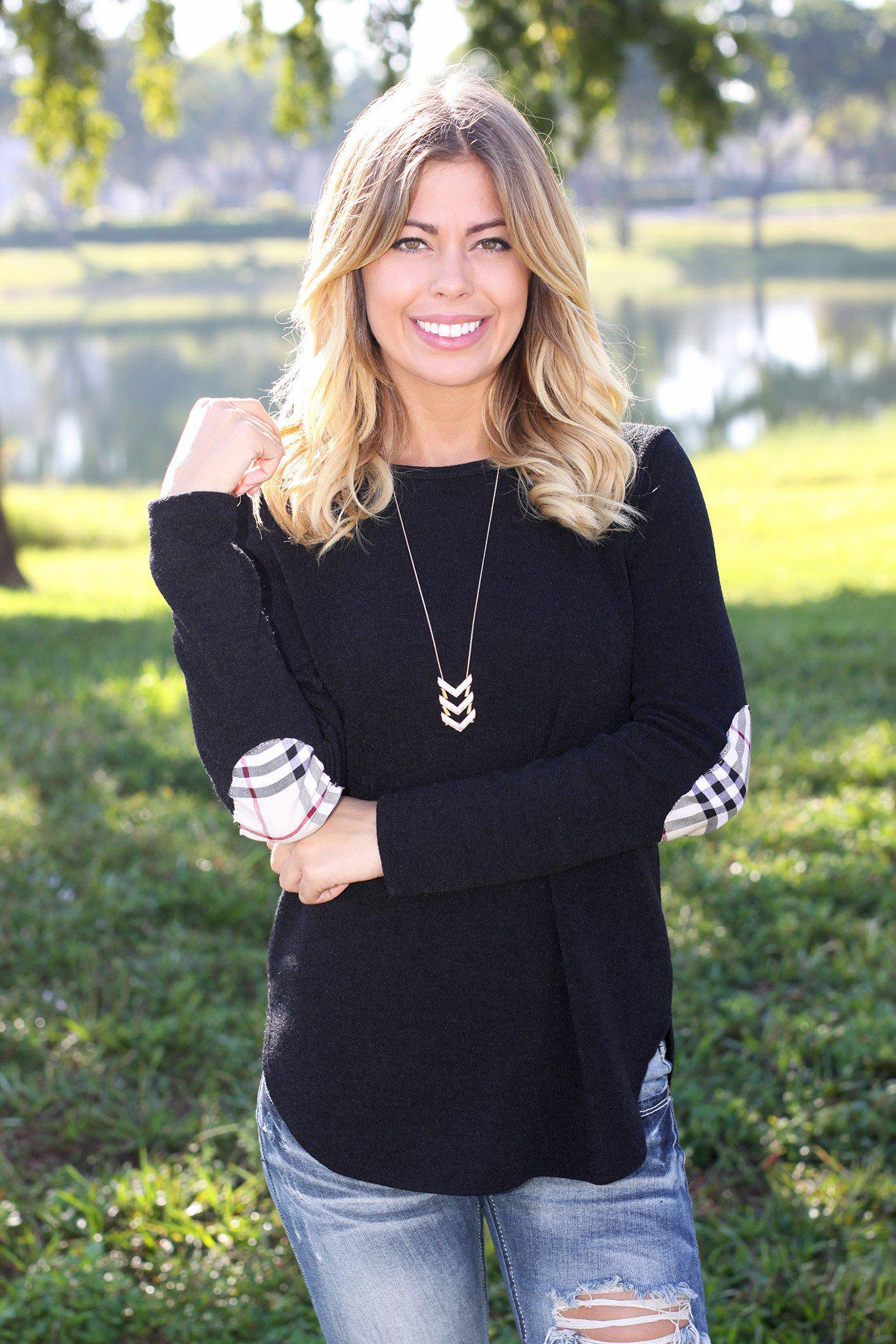 black sweater top with plaid elbow patches