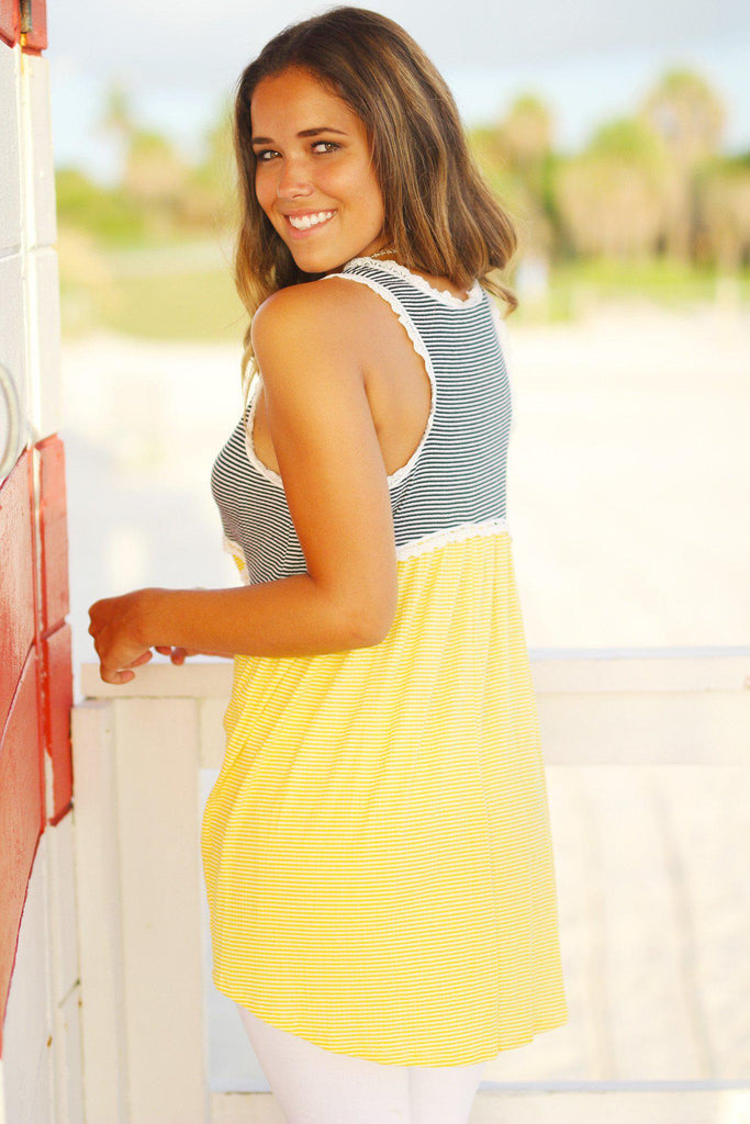 yellow sleeveless tunic top