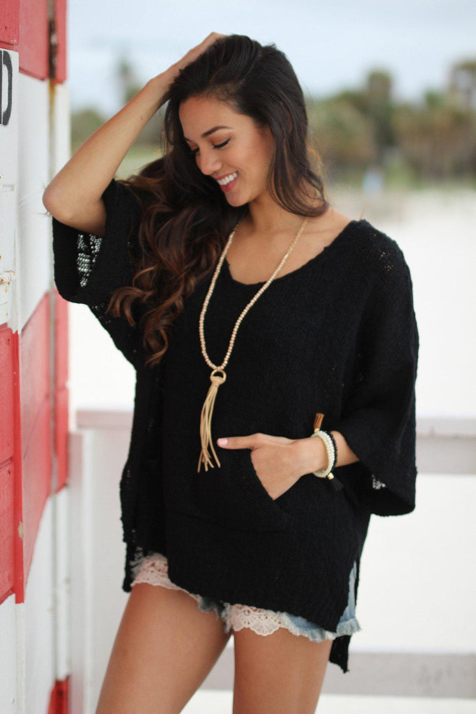 black sweater with pocket