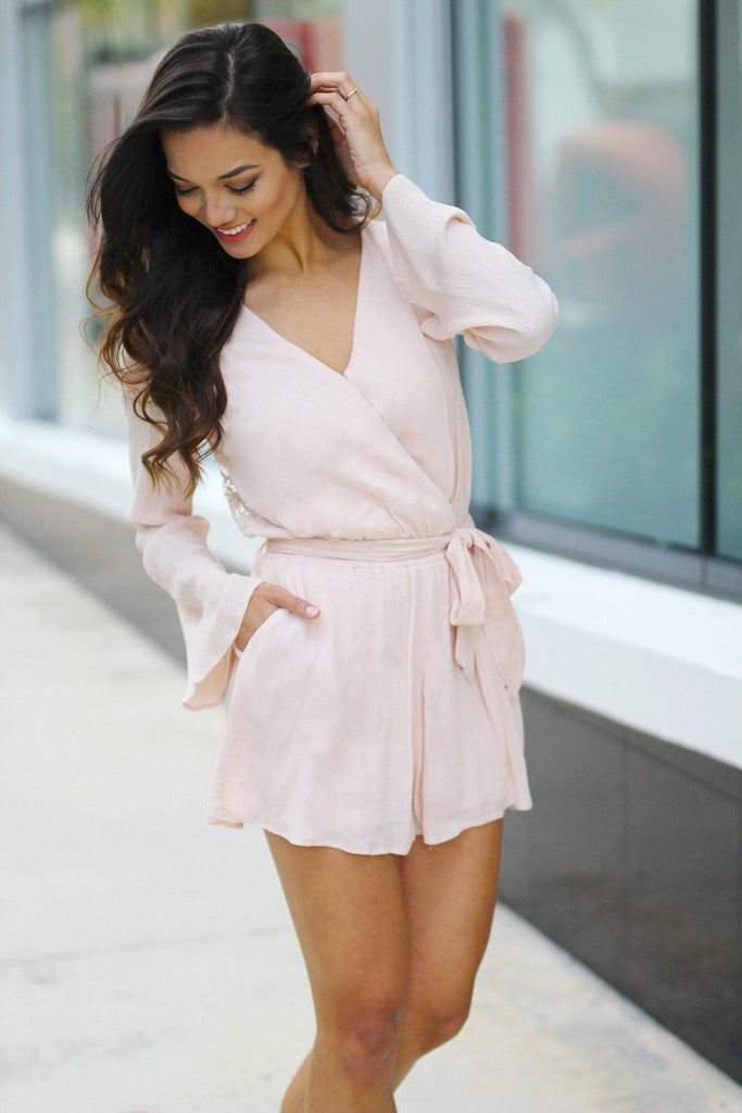 blush romper with crochet back
