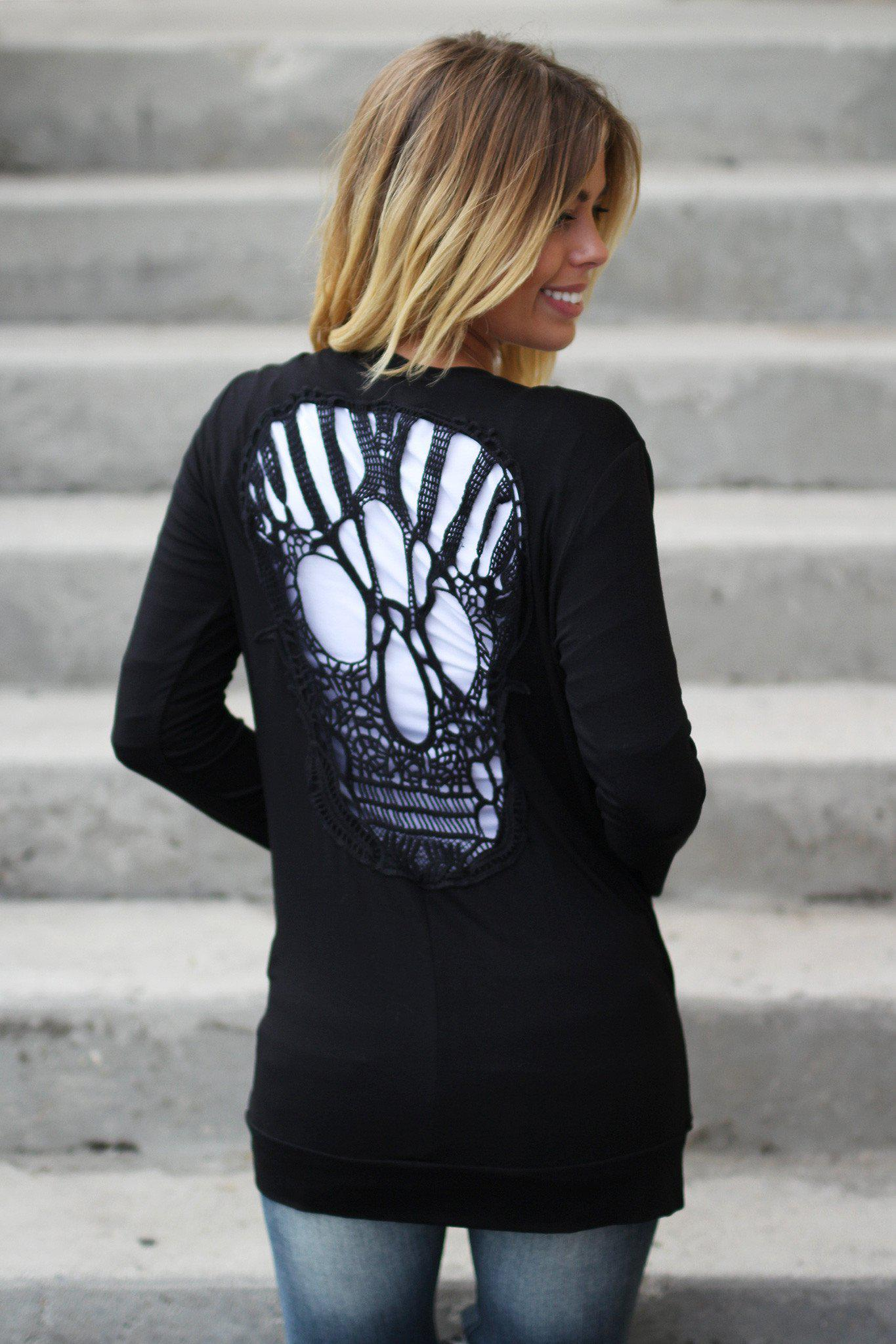 black cardigan with skull