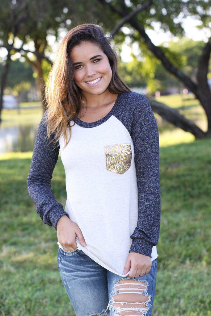 cream and charcoal long sleeve top with sequined pocket