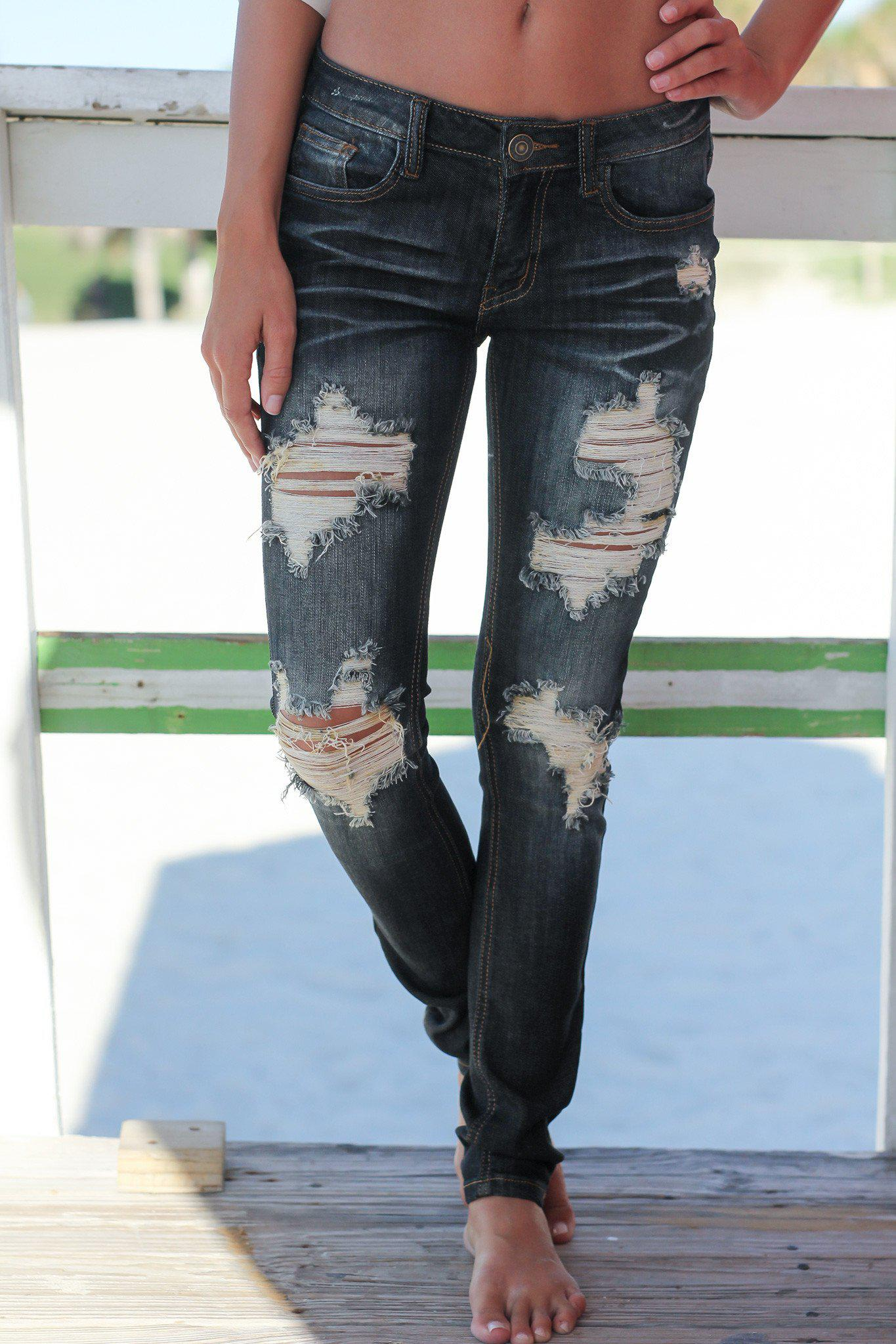 Dark destroyed skinny jeans