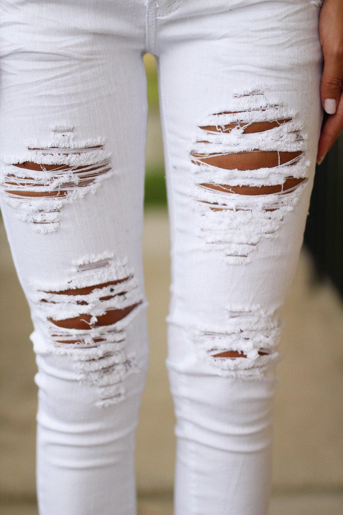 white jeans with rips