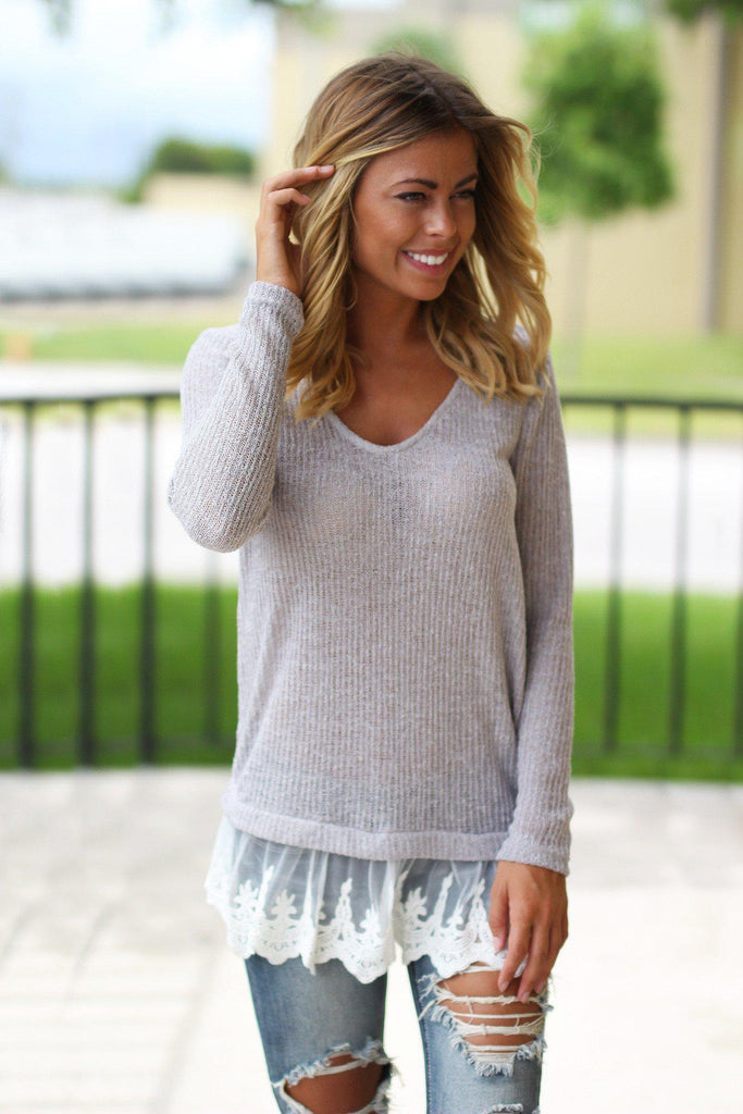 gray knit sweater with lace trim