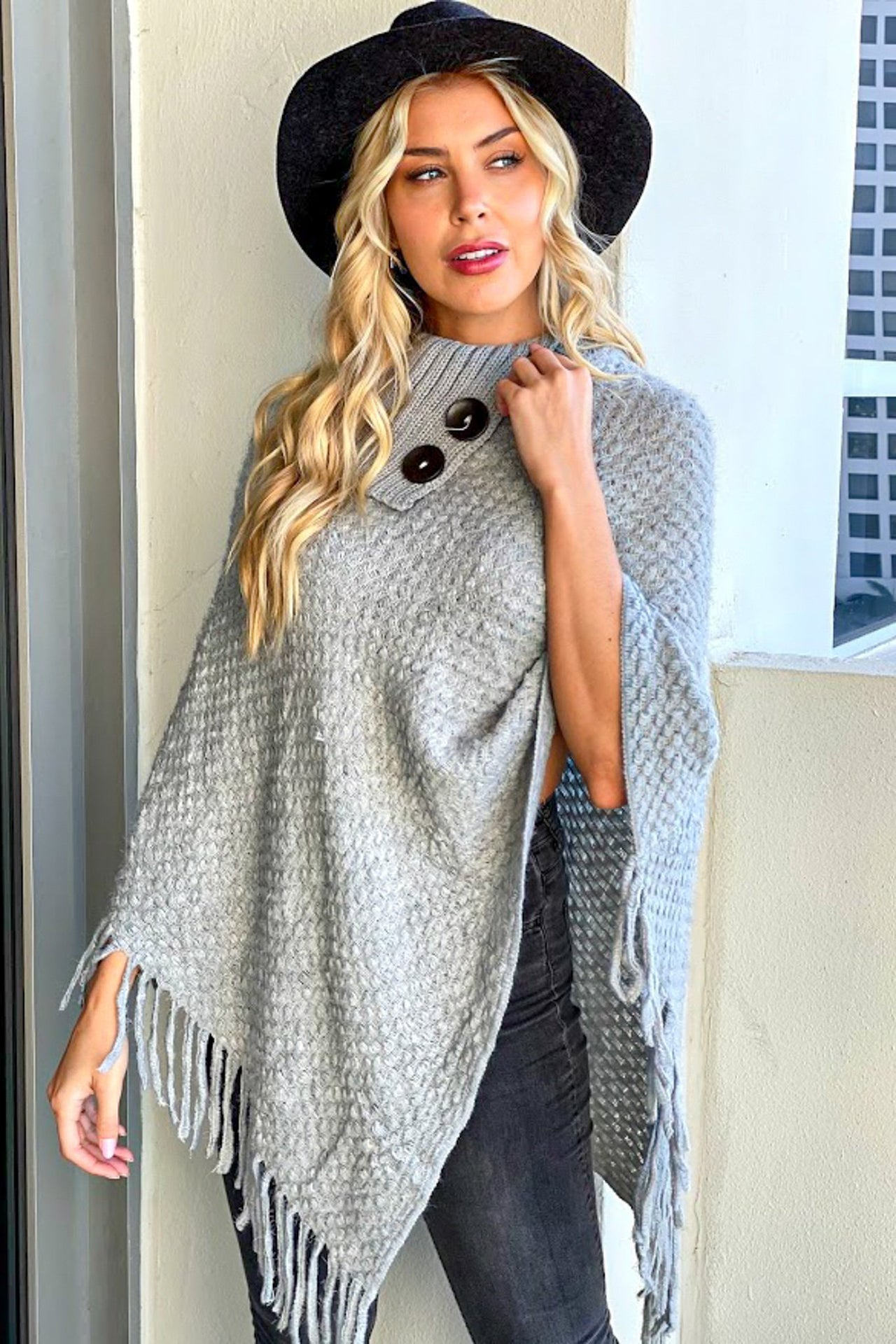 Woman in gray poncho