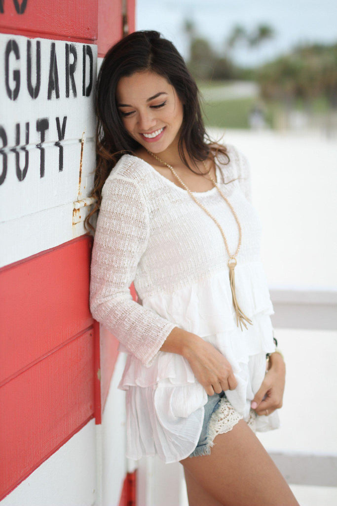 ruffled off white top
