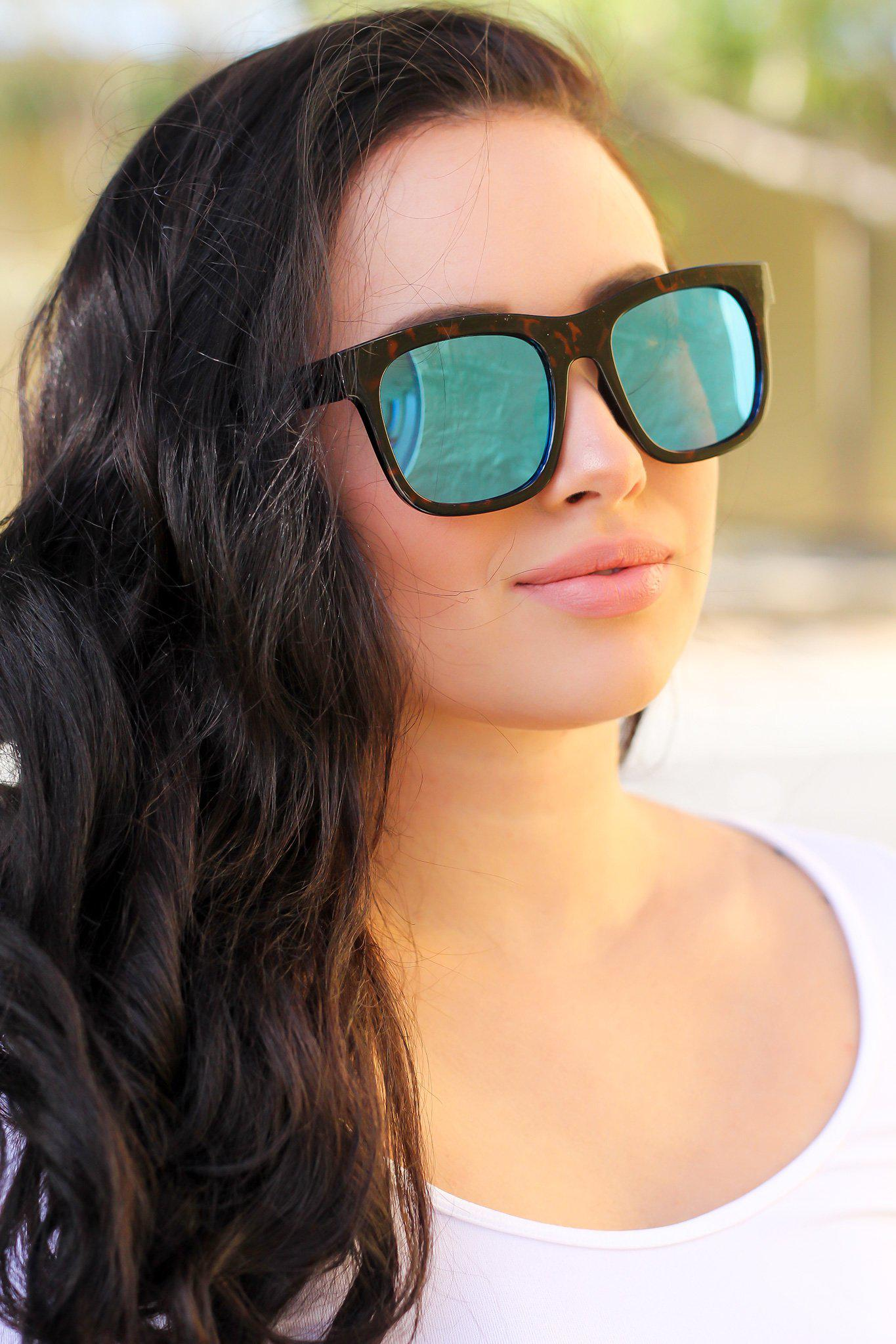 tortoise frame sunglasses with blue lenses