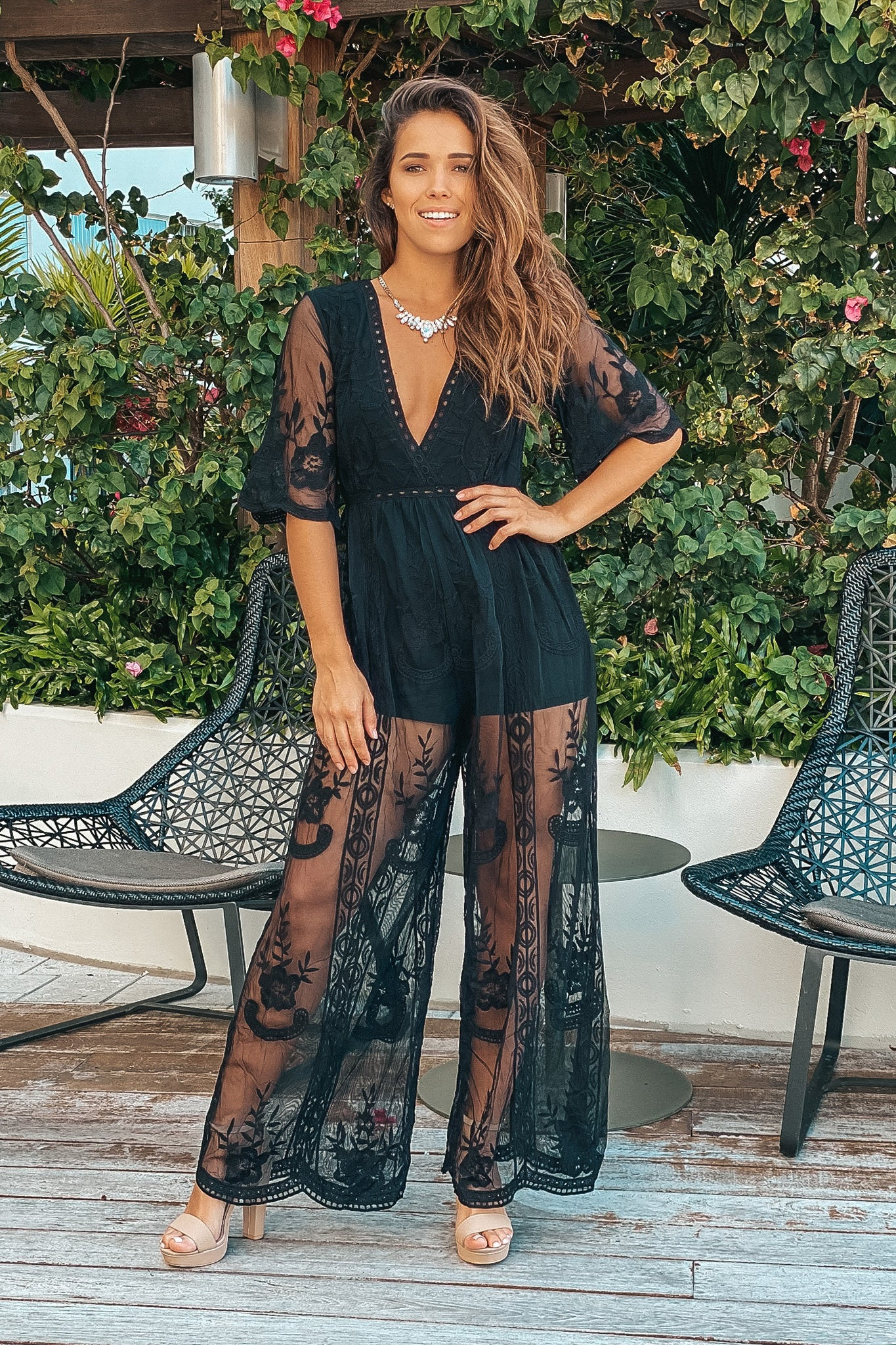 Black lace jumpsuit with sleeves