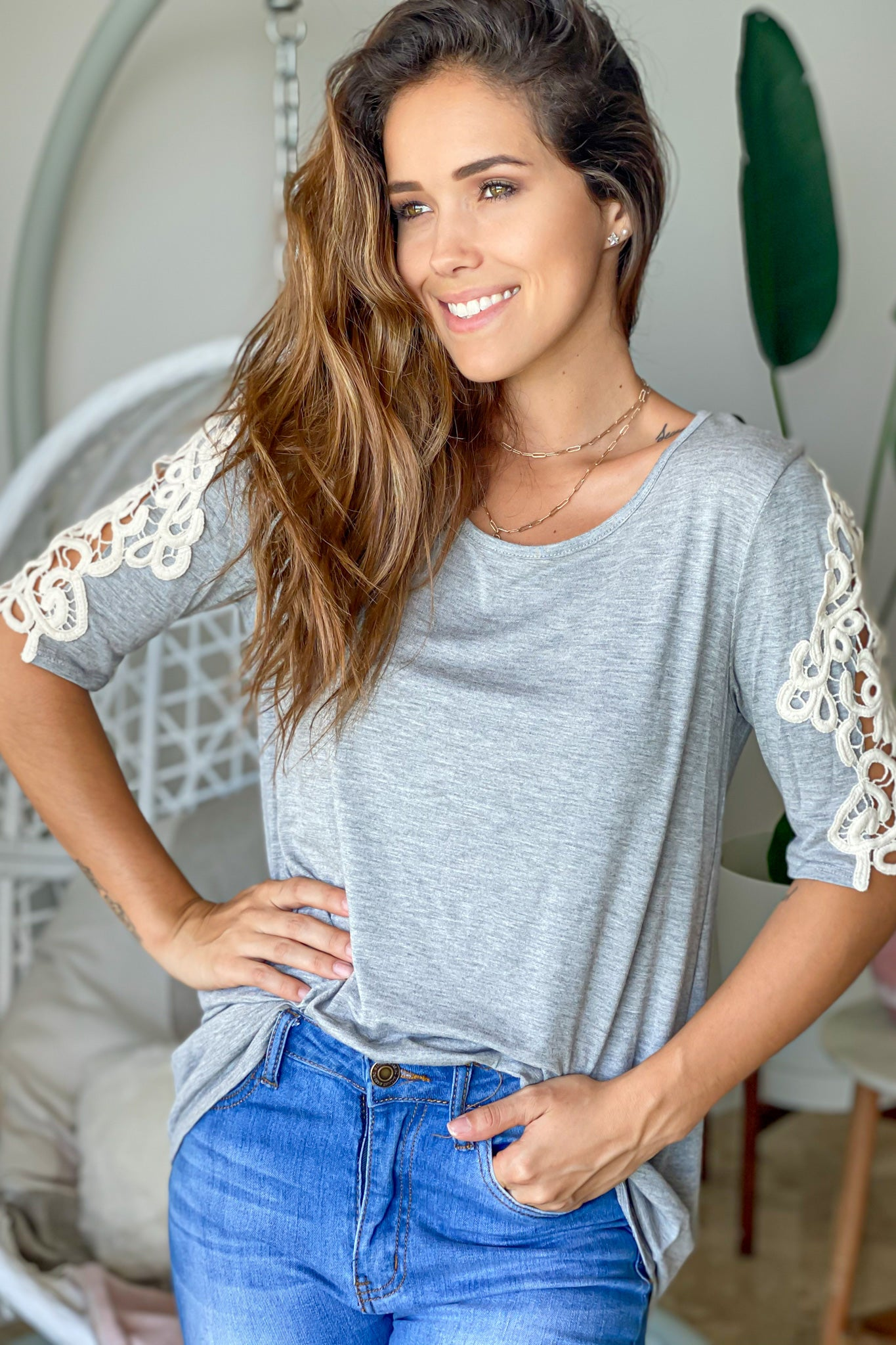 Lifestyle heather gray top with crochet sleeves