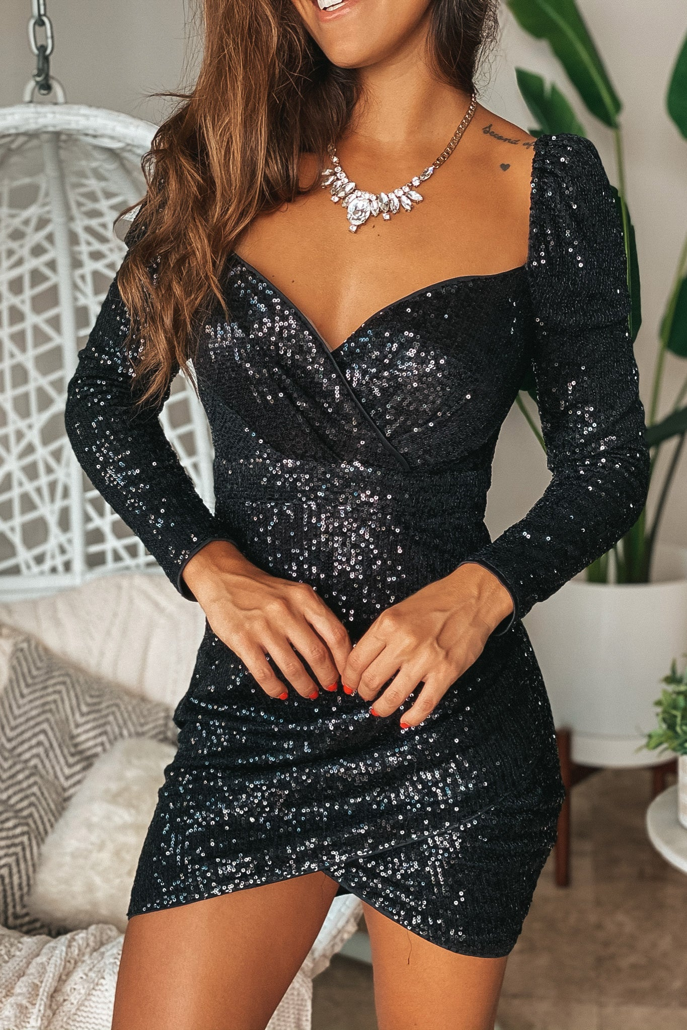 Lifestyle black short dress with sequins and long sleeves