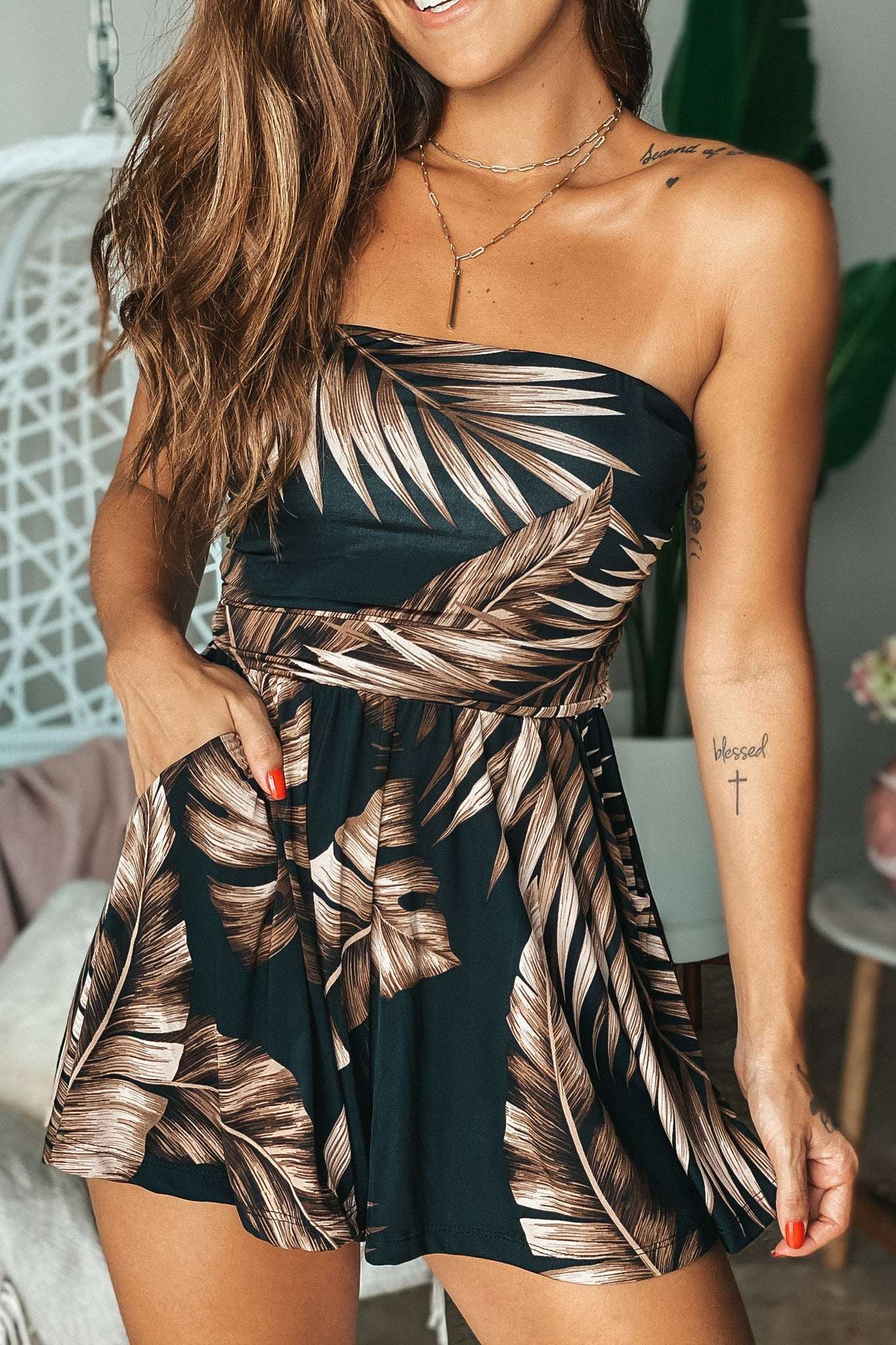 Lifestyle black strapless tropical romper