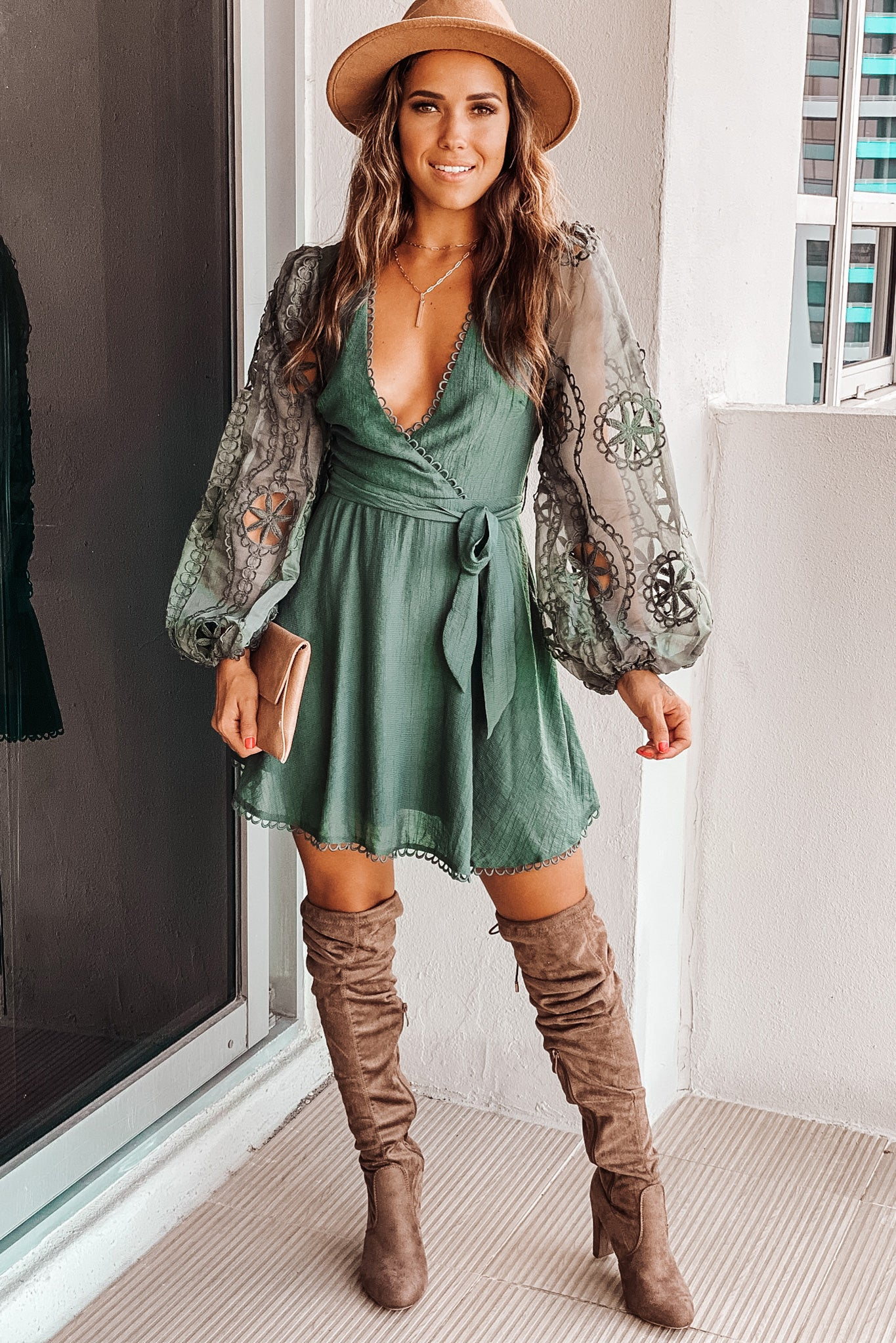 Lifestyle deep green short dress with puff sleeve detail
