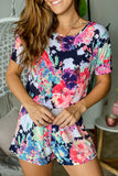 Lifestyle neon floral romper with short sleeves