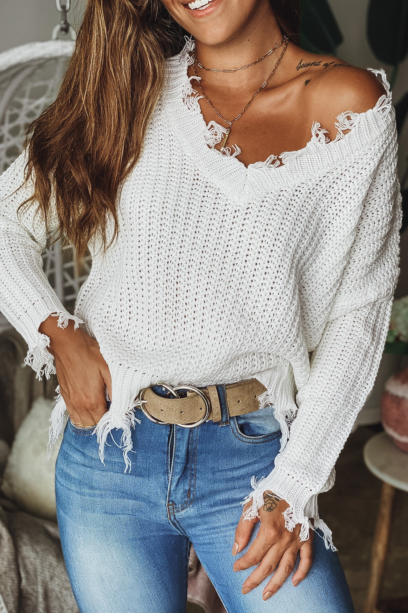Lifestyle off white distressed v-neck sweater