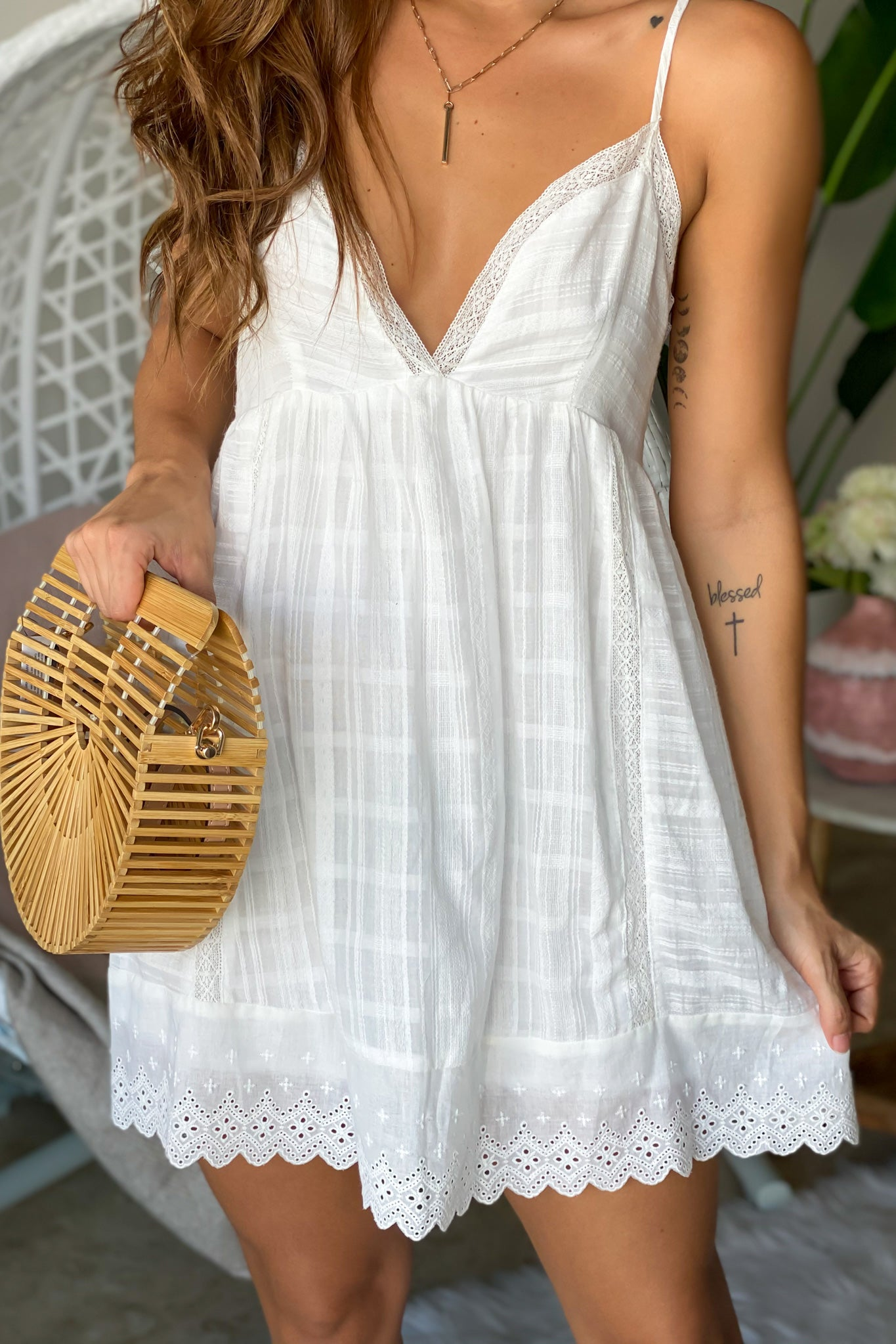 Lifestyle off white romper with tie back