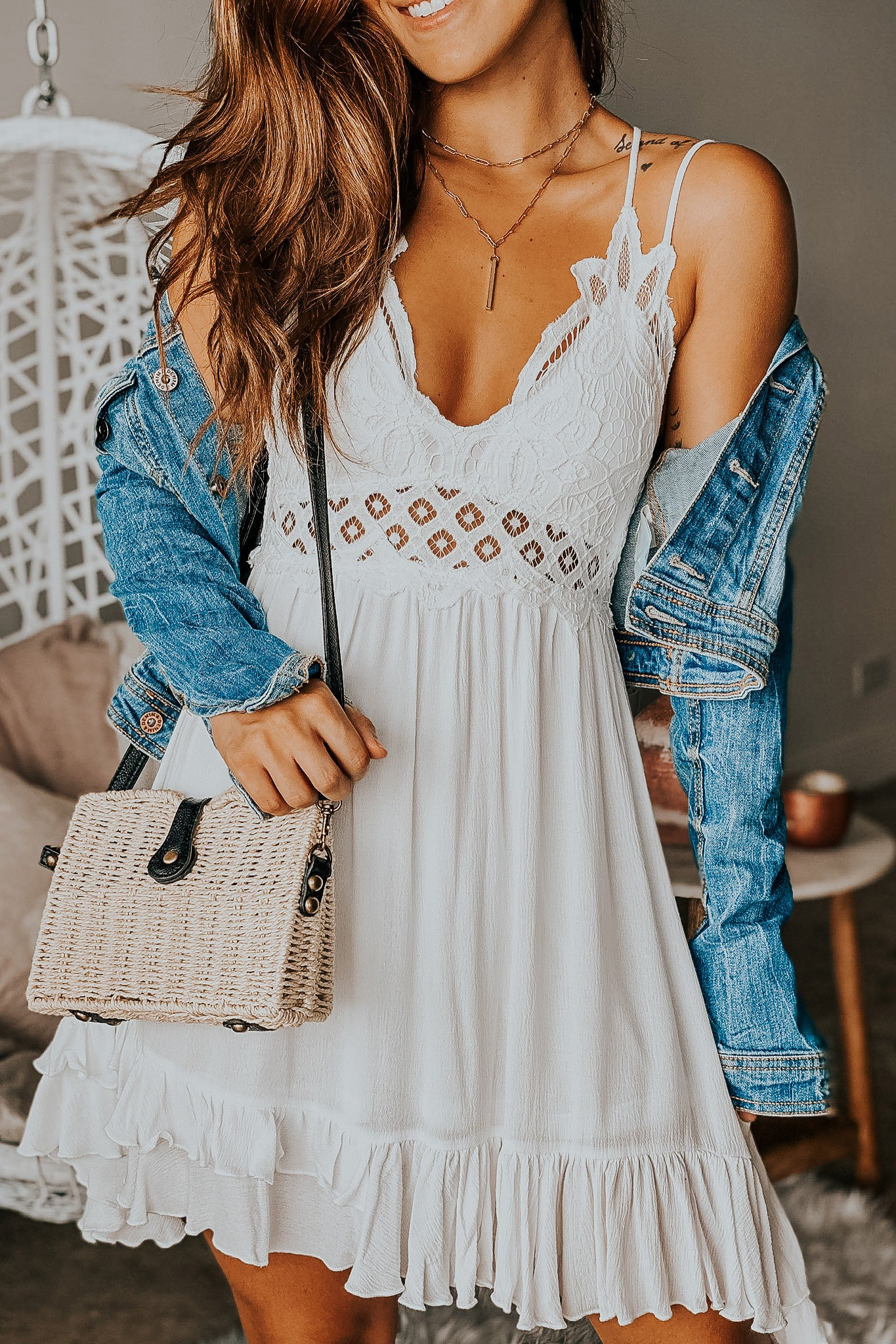 Lifestyle white crochet top short dress with criss cross back