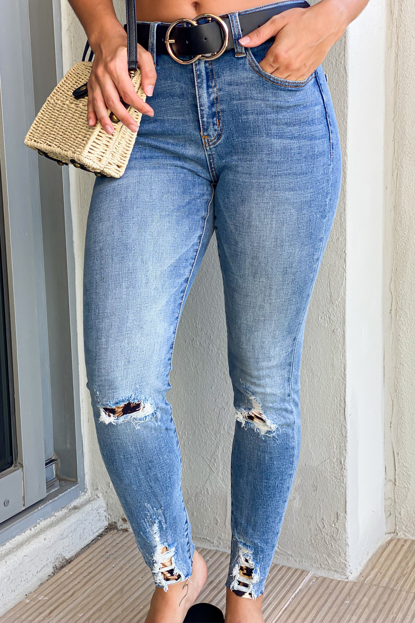 medium wash jeans with leopard print details