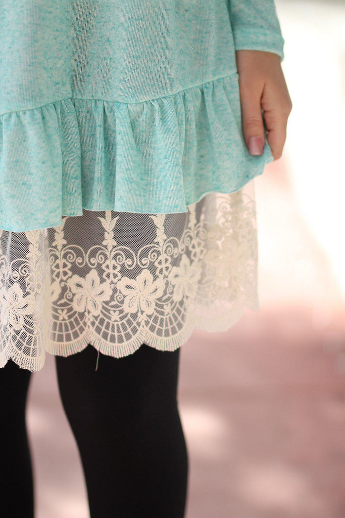 mint top with lace details