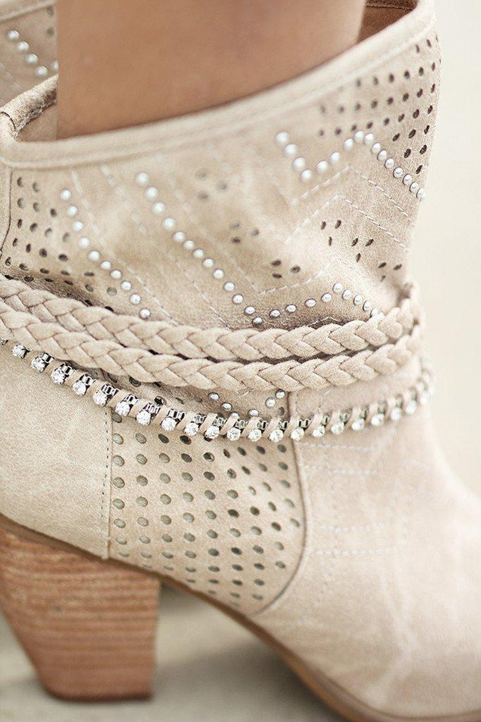 beige boots with feather detailing