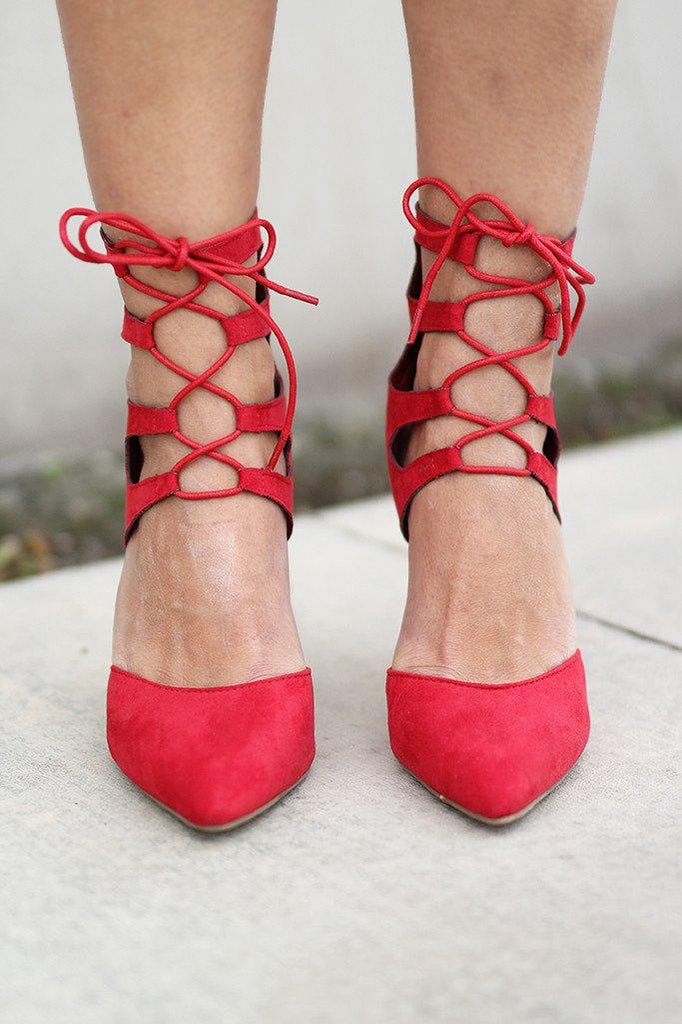 red strappy heelps