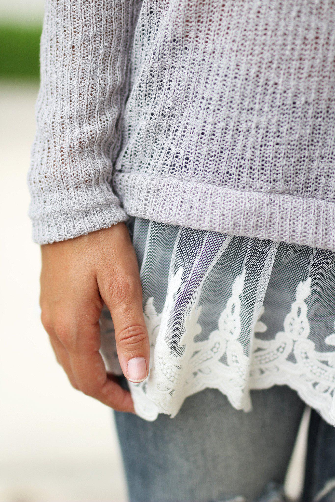 gray knitted sweater with lace trim