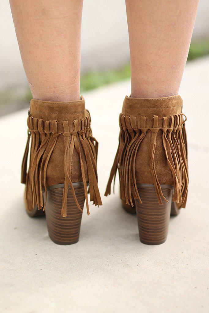 tan boots with fringe