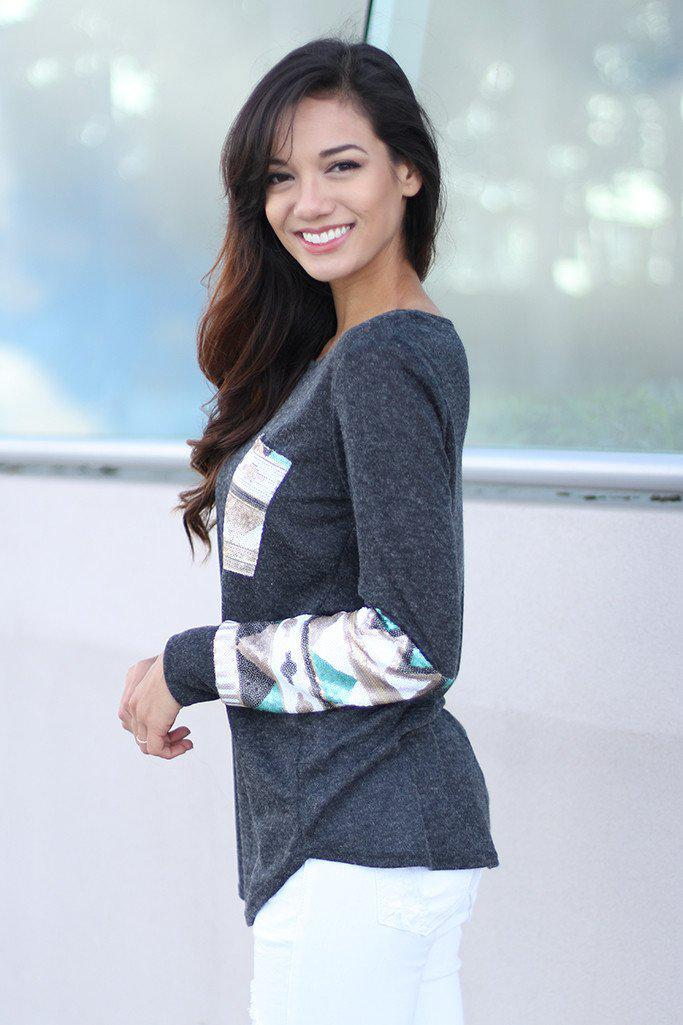 top with sequined sleeves