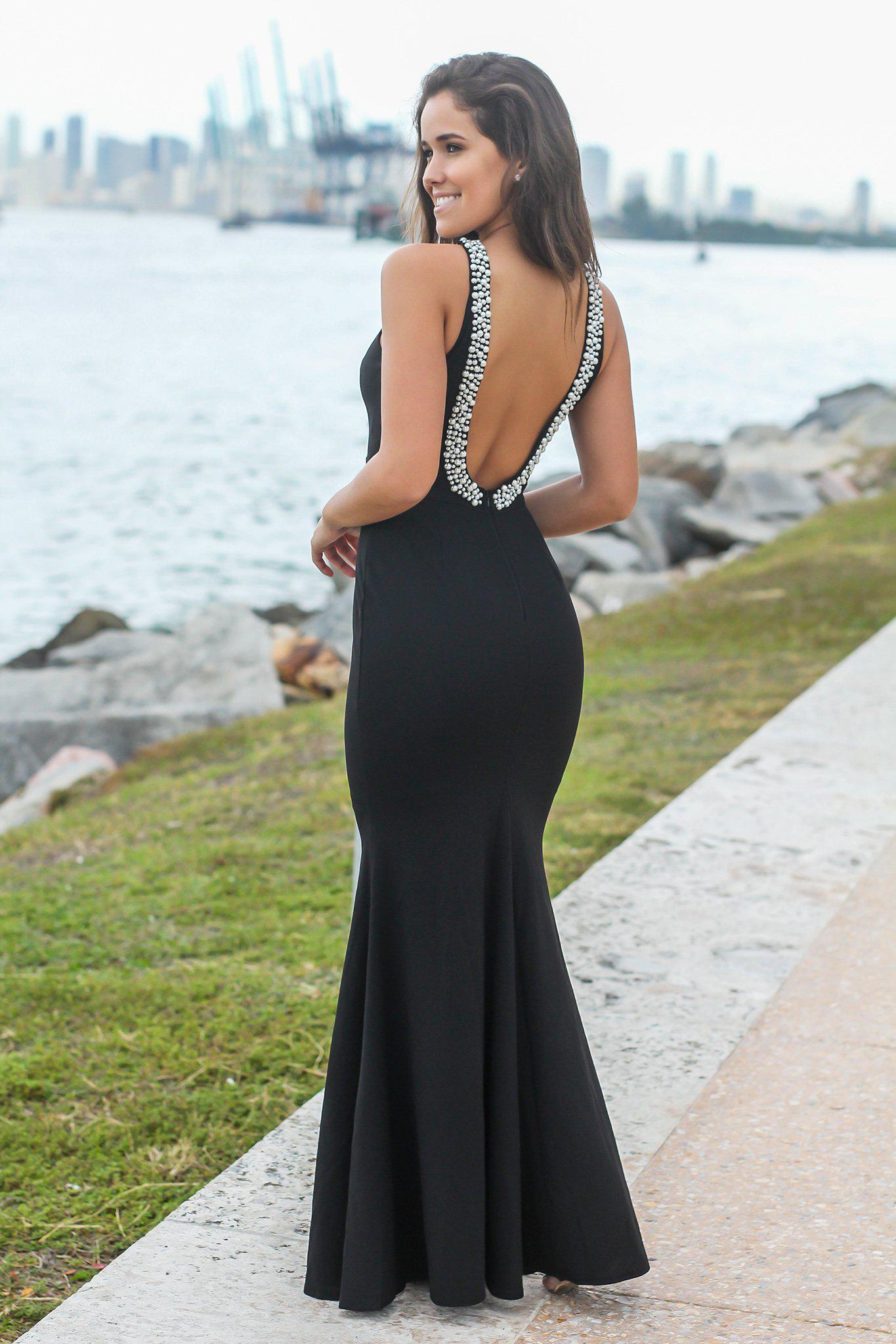black maxi dress with open back and pearl detail