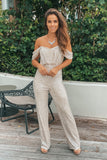 beige and silver sequined off shoulder jumpsuit