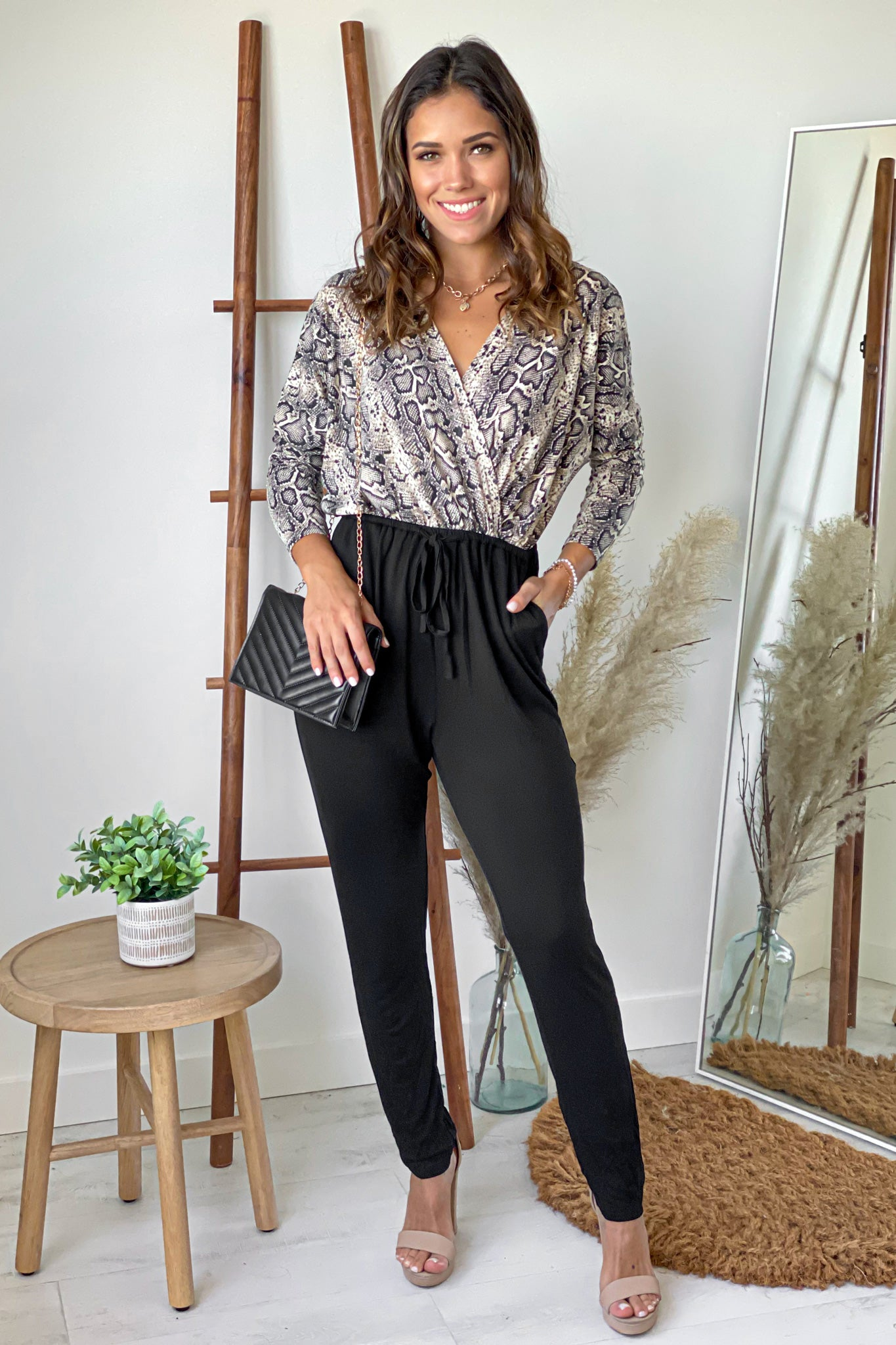 black and snake print jumpsuit