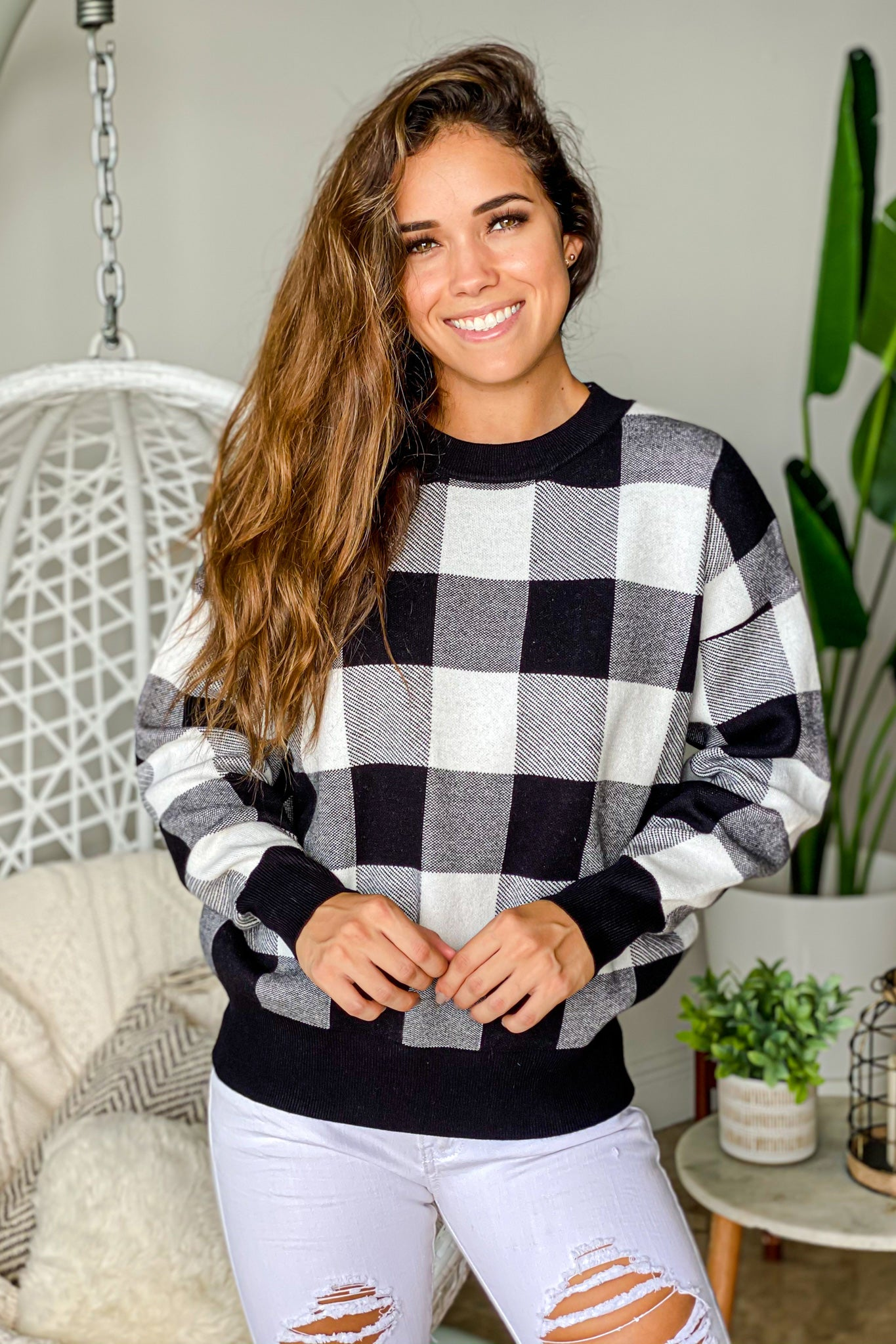 black and white checkered pullover