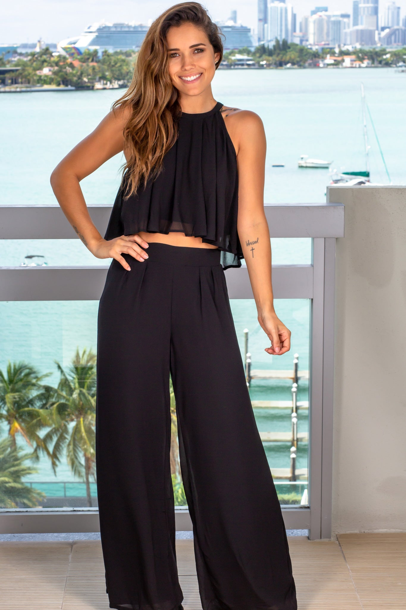 black draped top and pants set