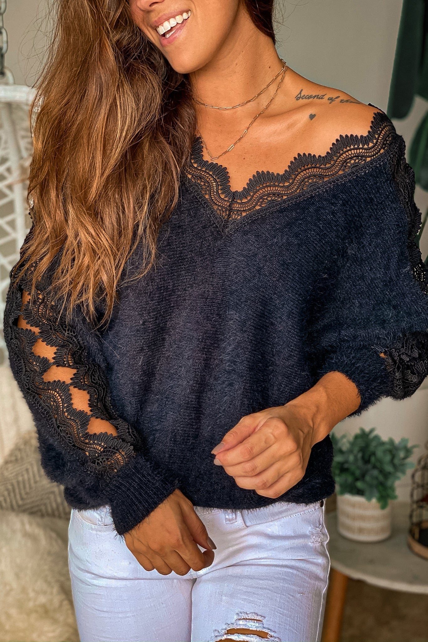 black fuzzy top with crochet detail