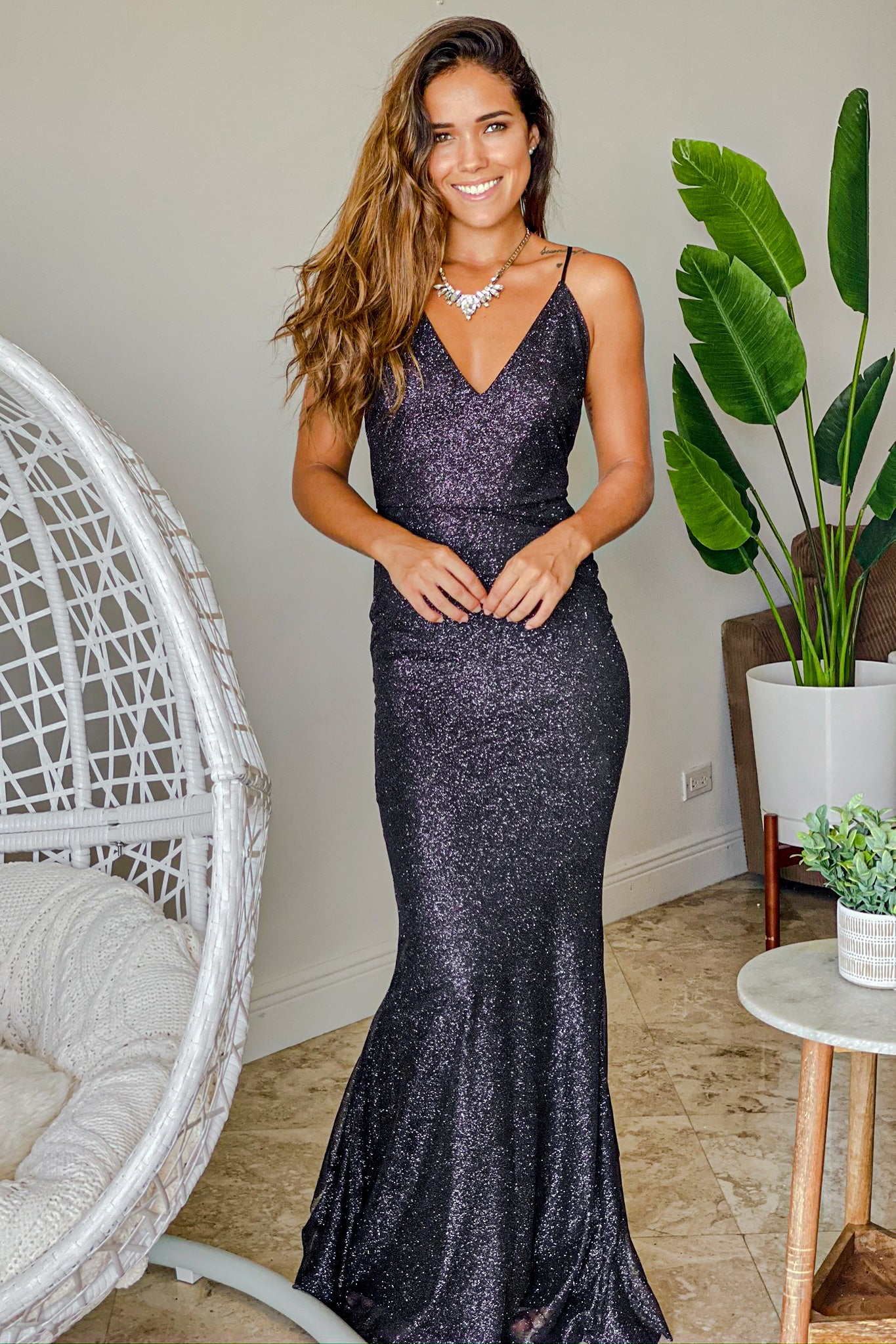 black glitter maxi dress with bow ruffle details