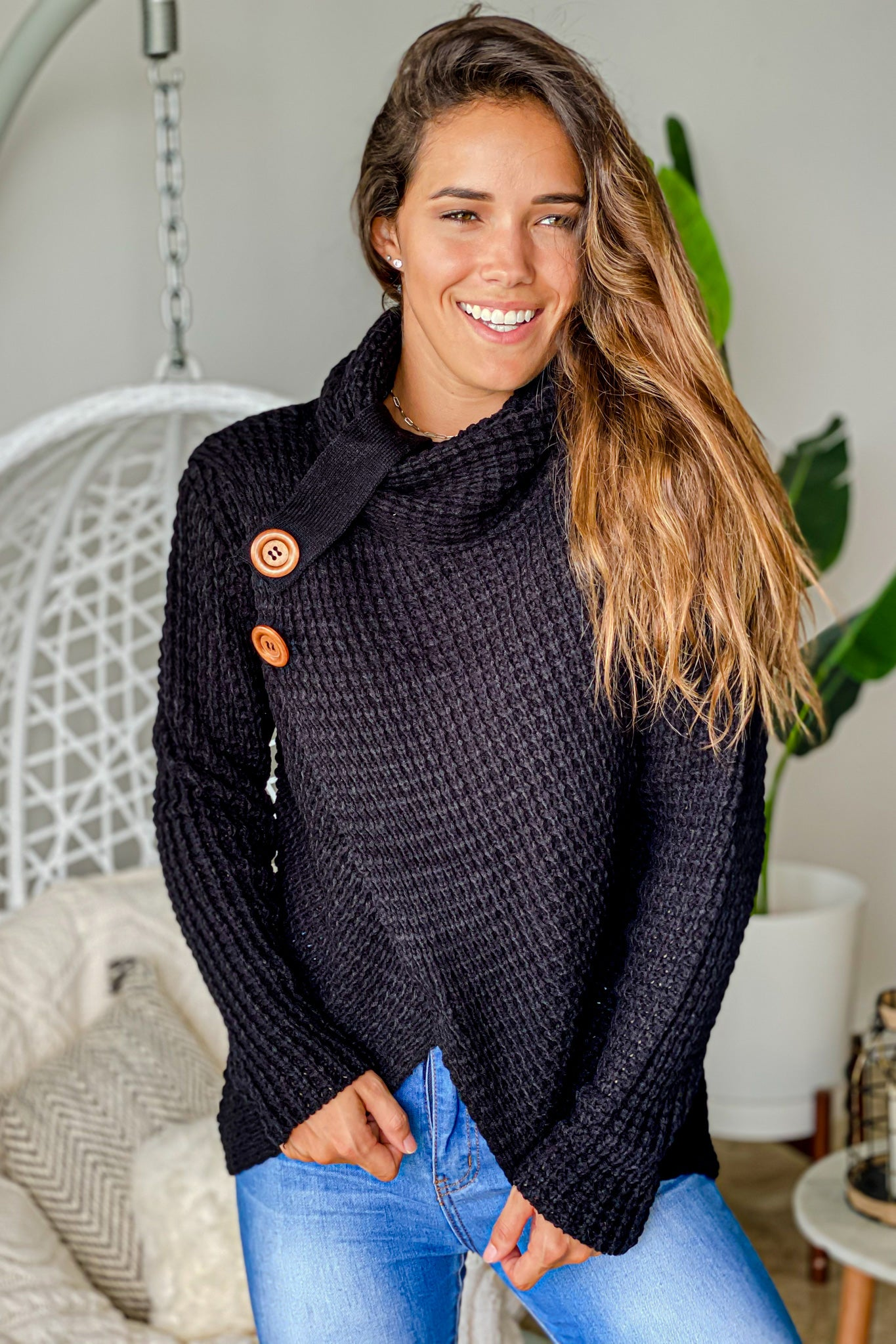 black knit asymmetrical sweater with buttons