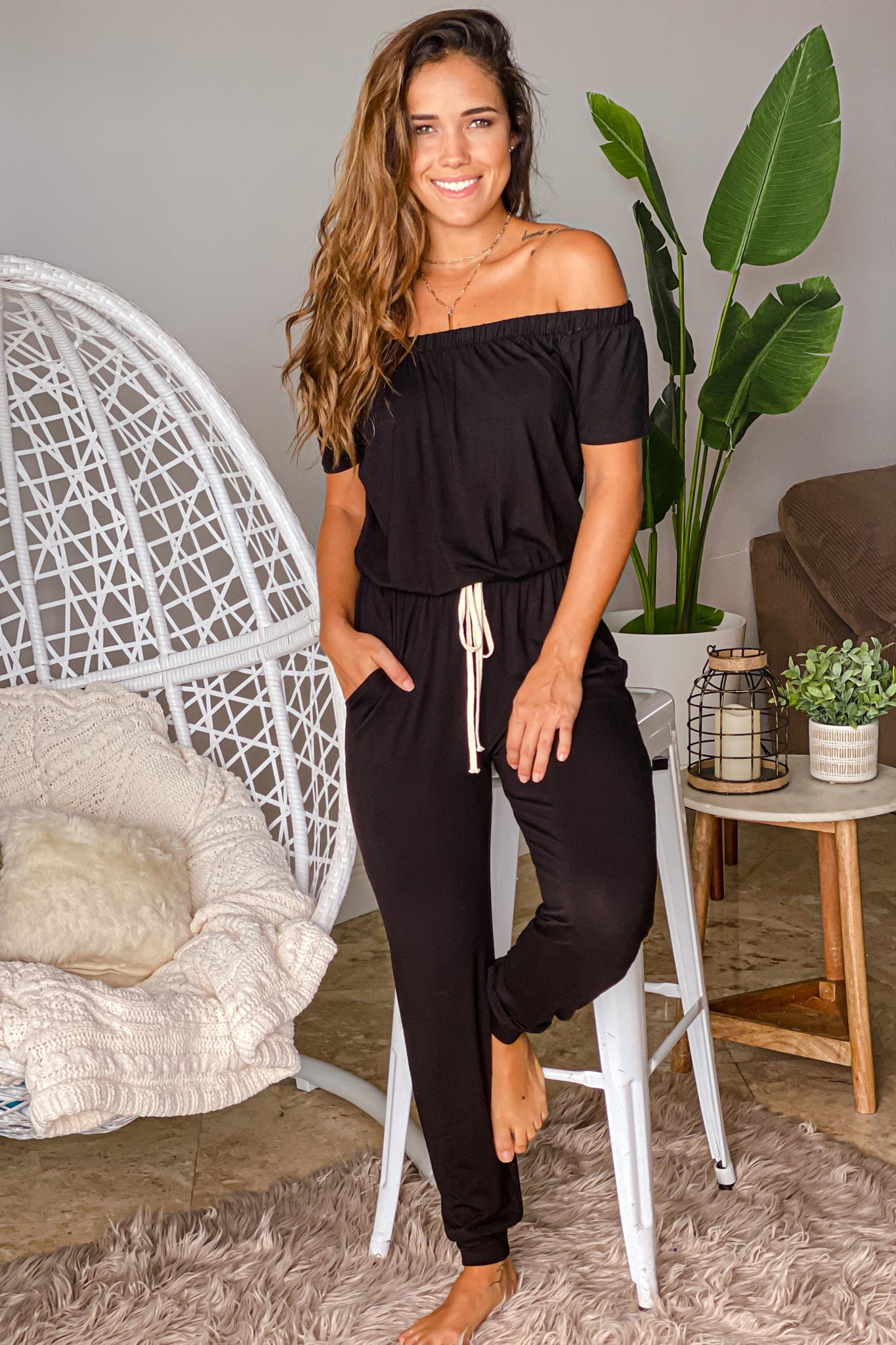 black off shoulder jumpsuit with drawsting