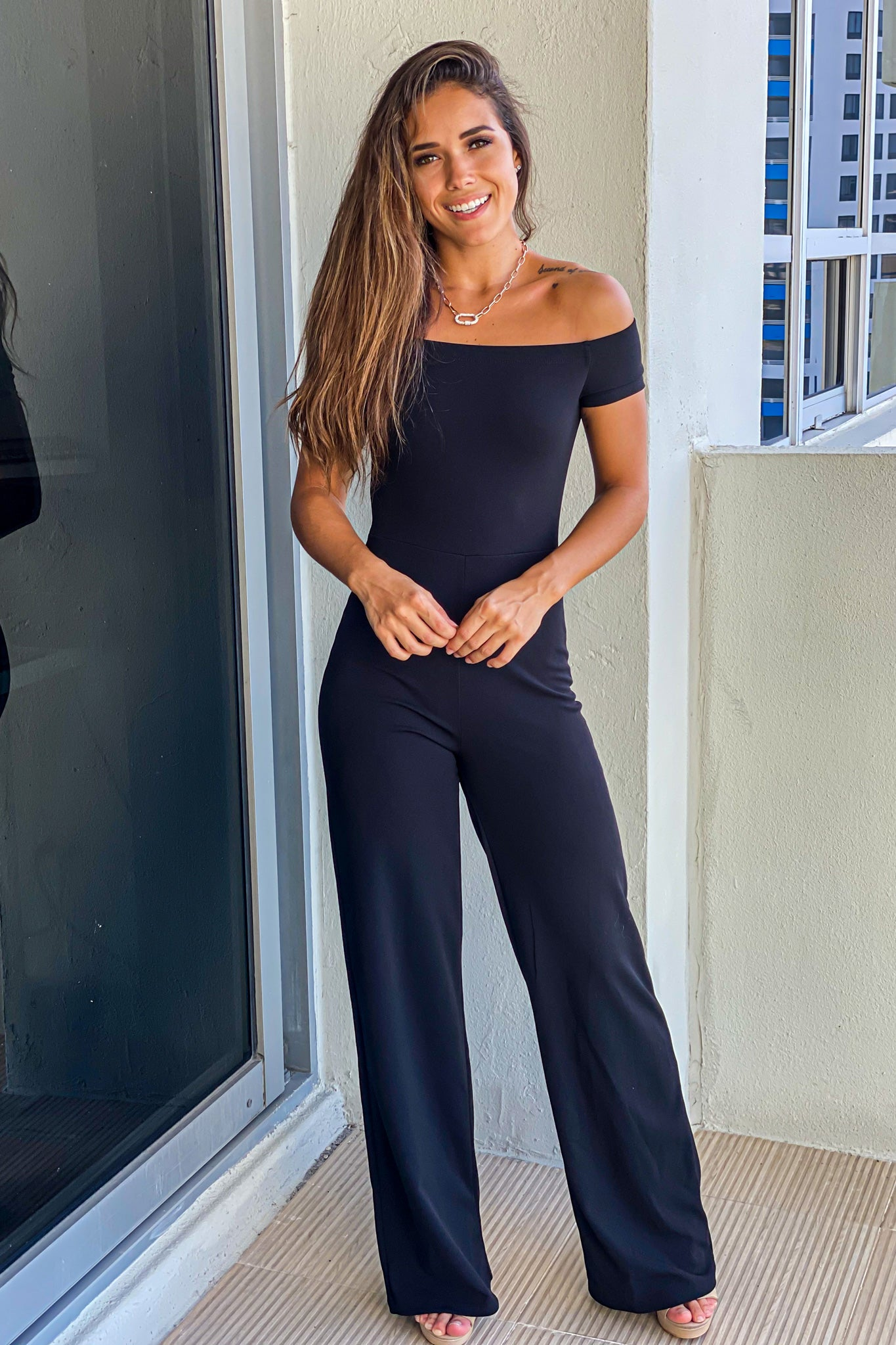 black short sleeve off shoulder jumpsuit