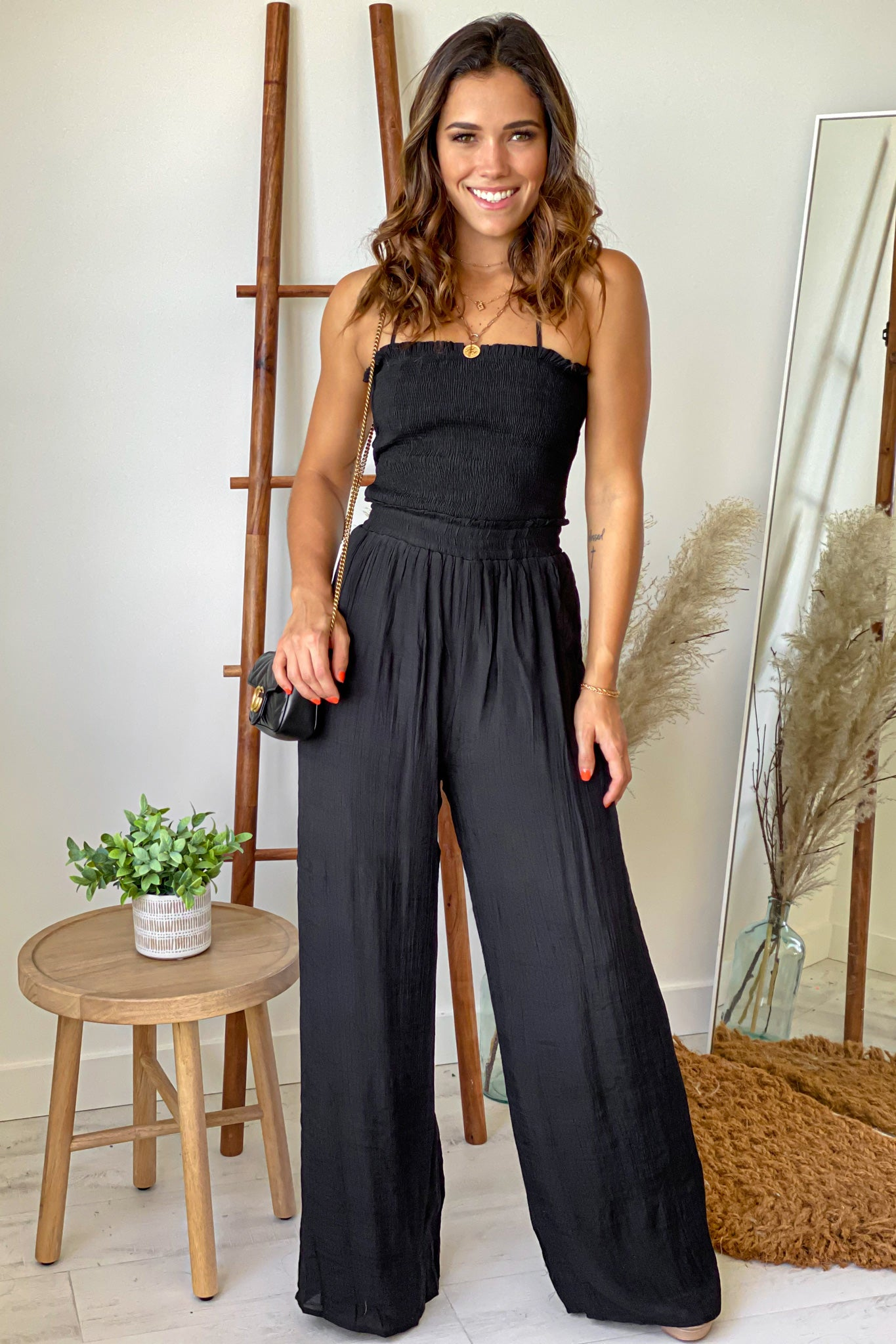 black strapless jumpsuit with smocked top