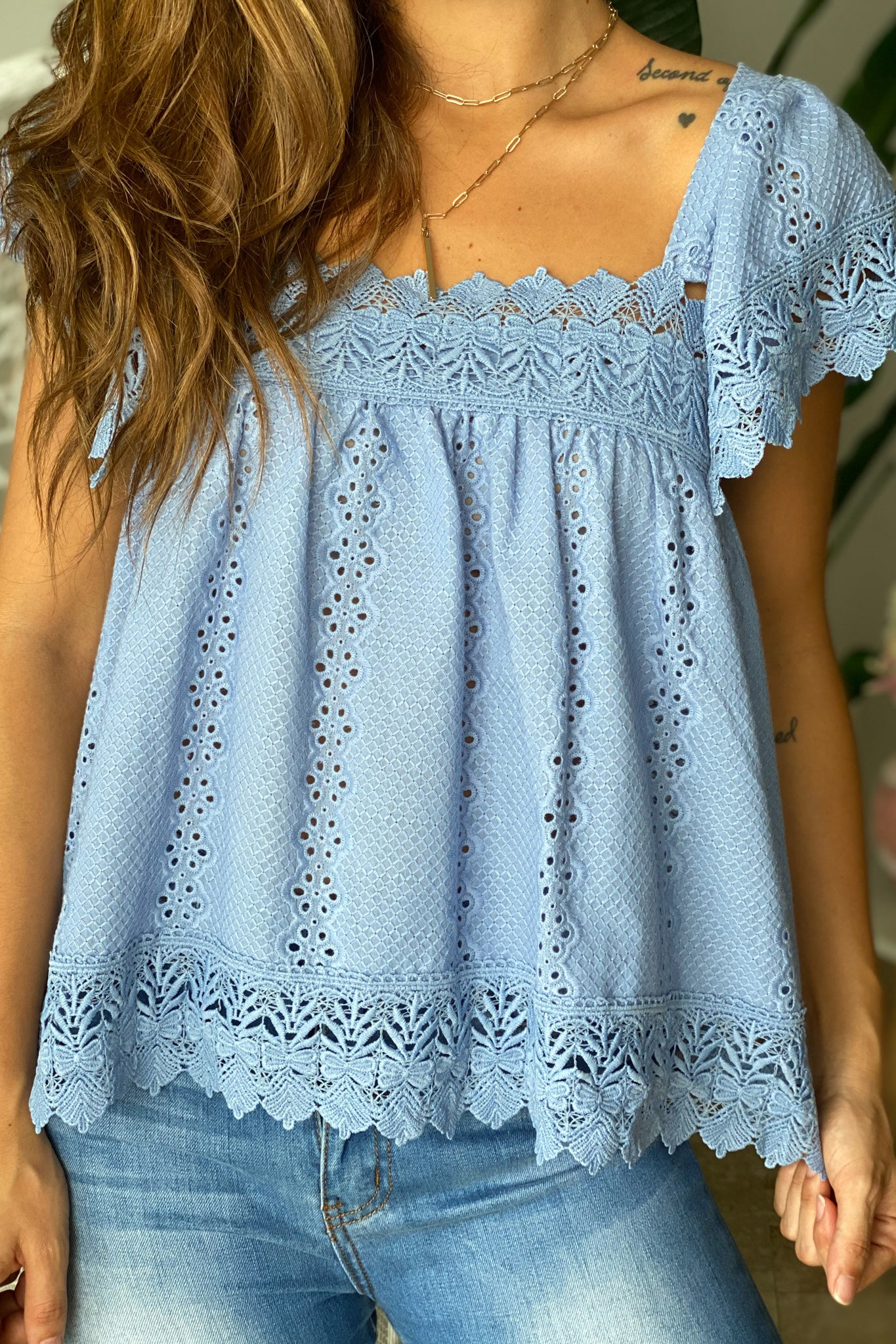 Lifestyle blue top with embroidered detail