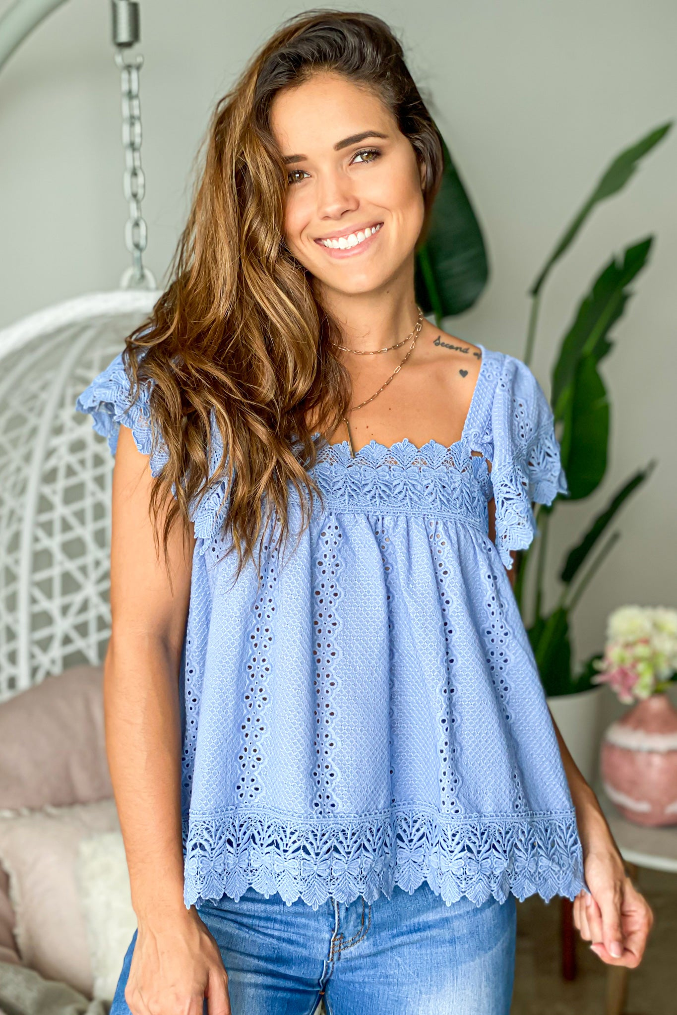 blue top with embroidered detail