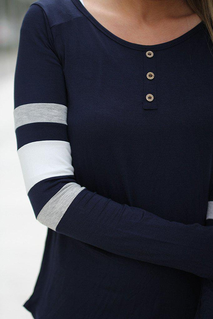 navy top with button details