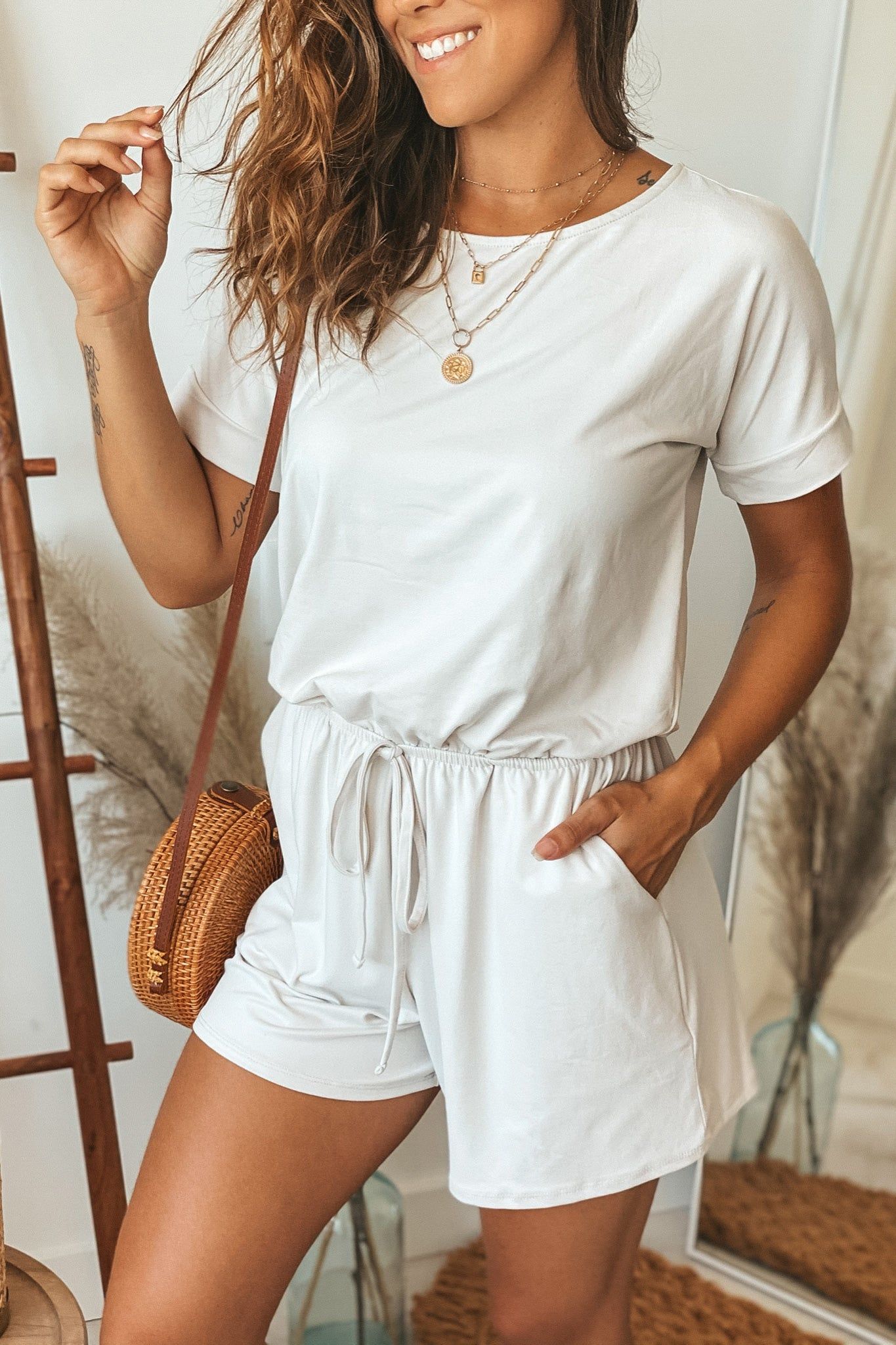 bone romper with pockets and sleeves