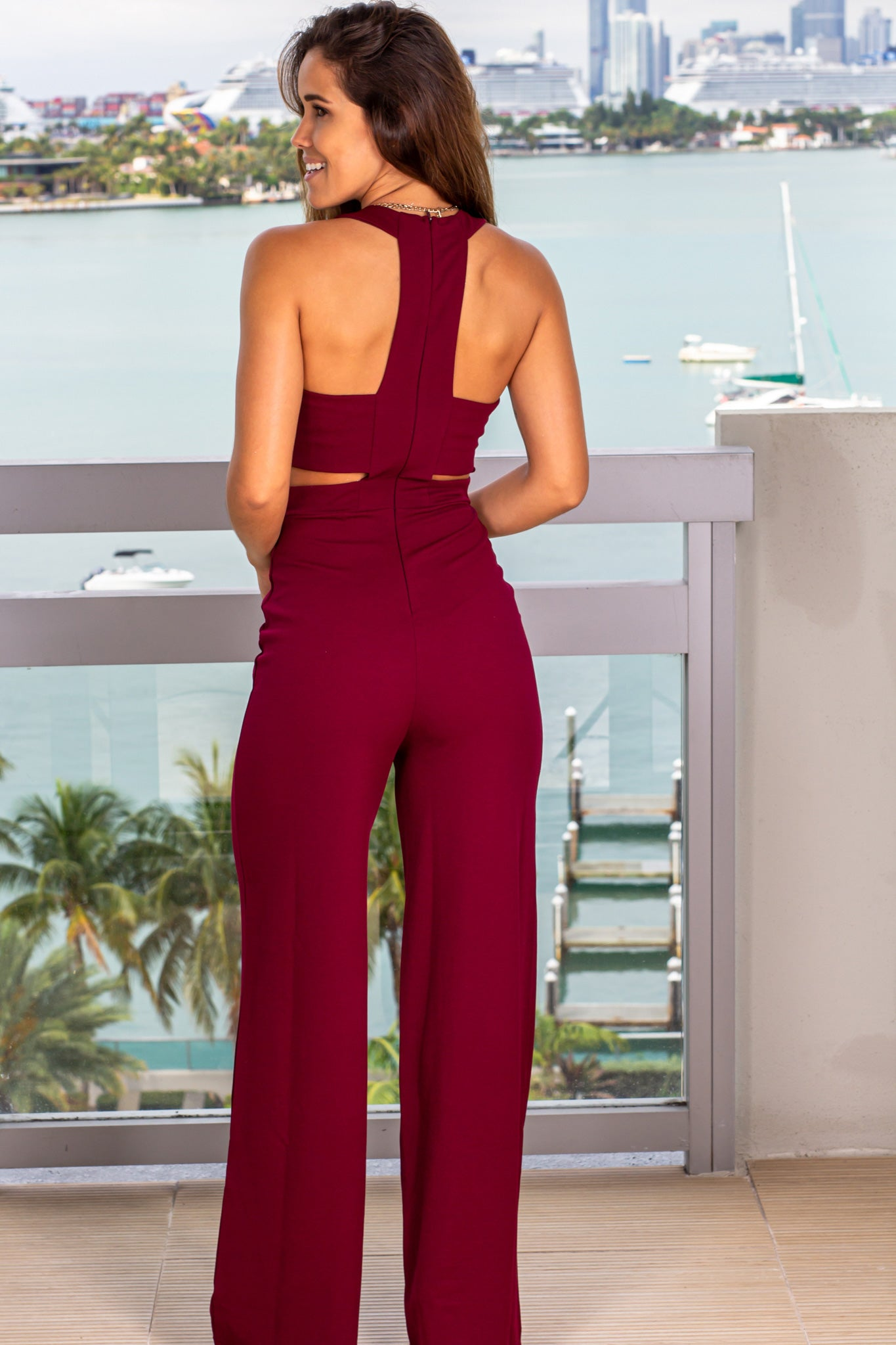 burgundy jumpsuit with open back