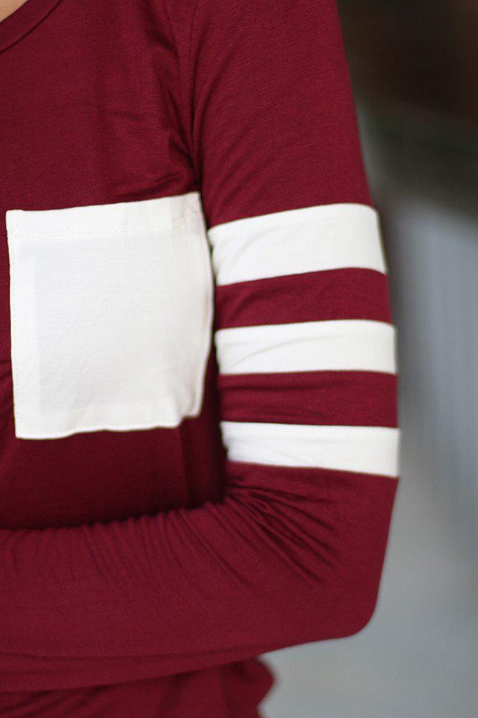 burgundy top with white pocket