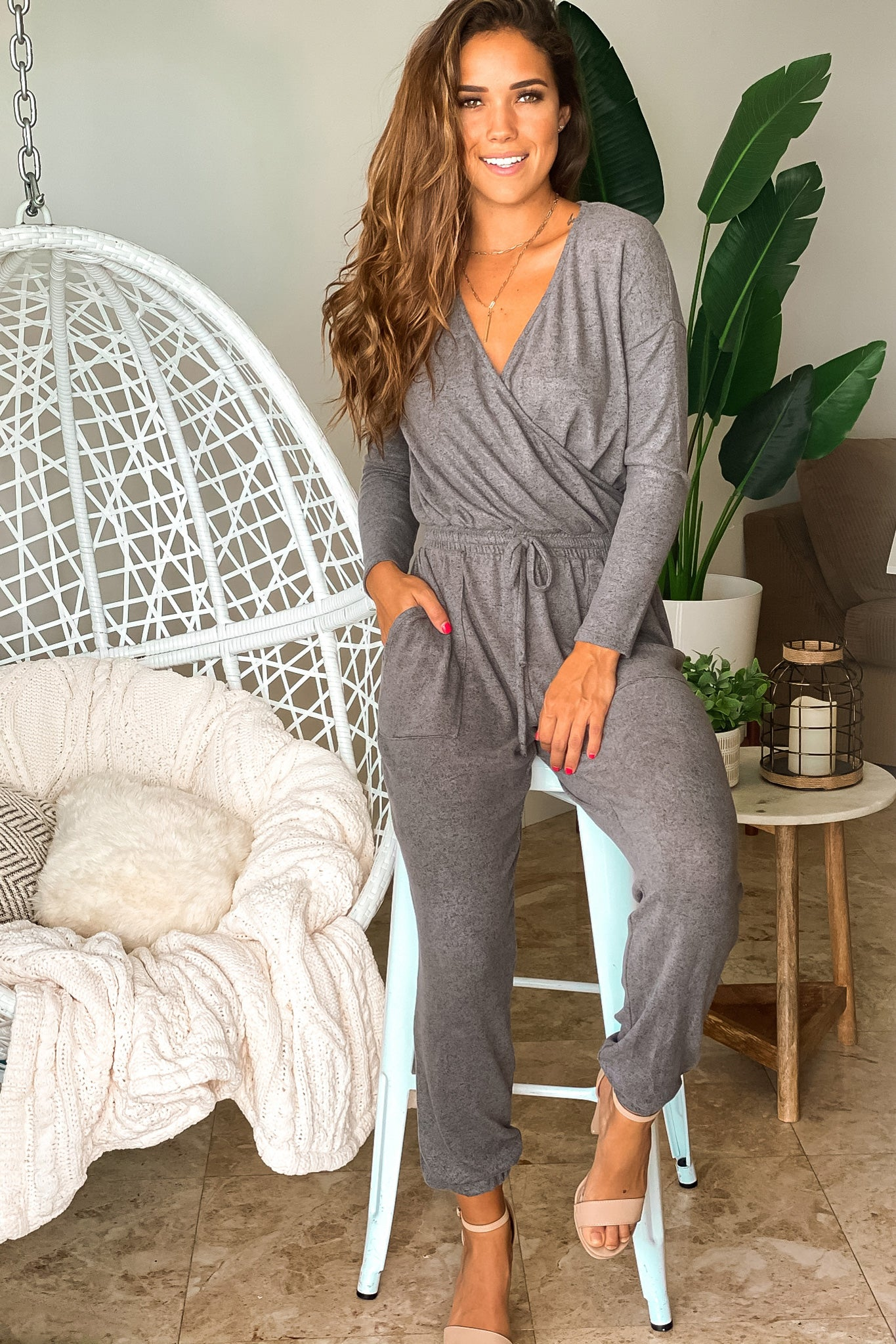 charcoal v-neck jumpsuit with long sleeves
